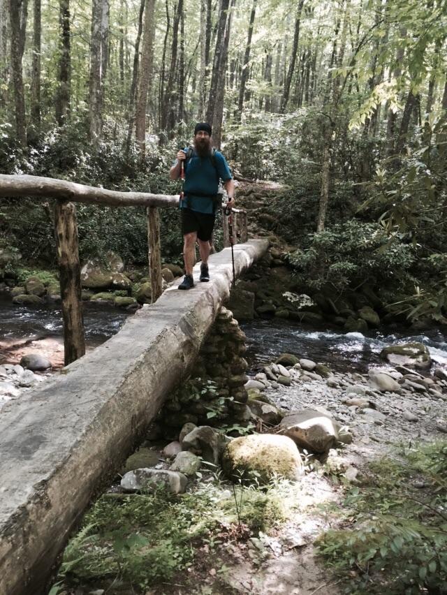 NoKey crossing Deep Creek on a foot bridge