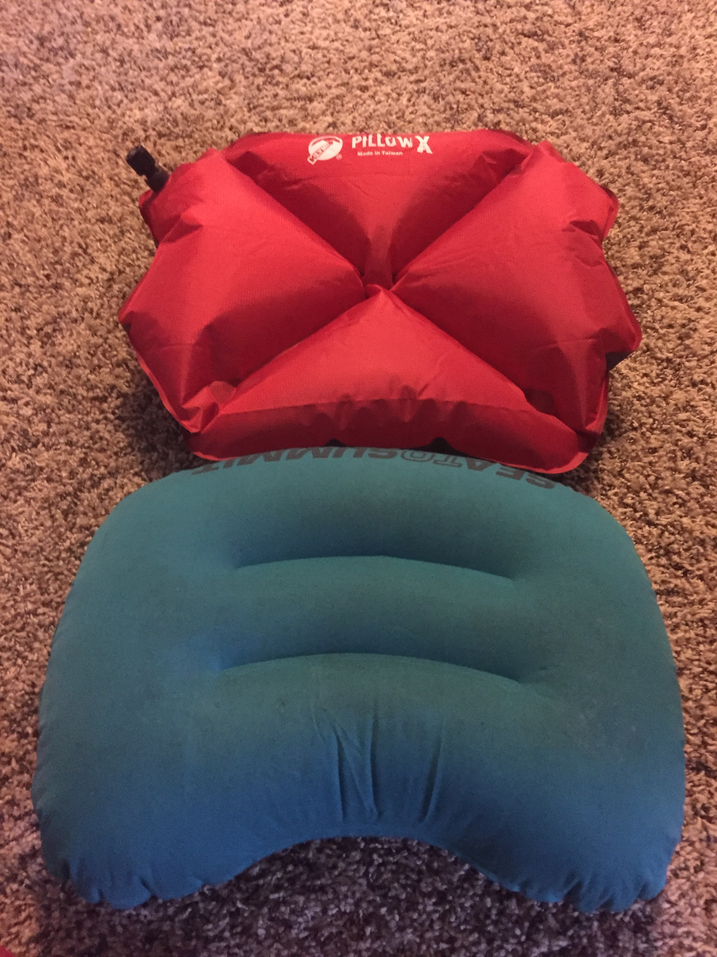 The red pillow above is the Klymit Pillow X; the green pillow below is the Sea to Summit Aeros Ultralight.