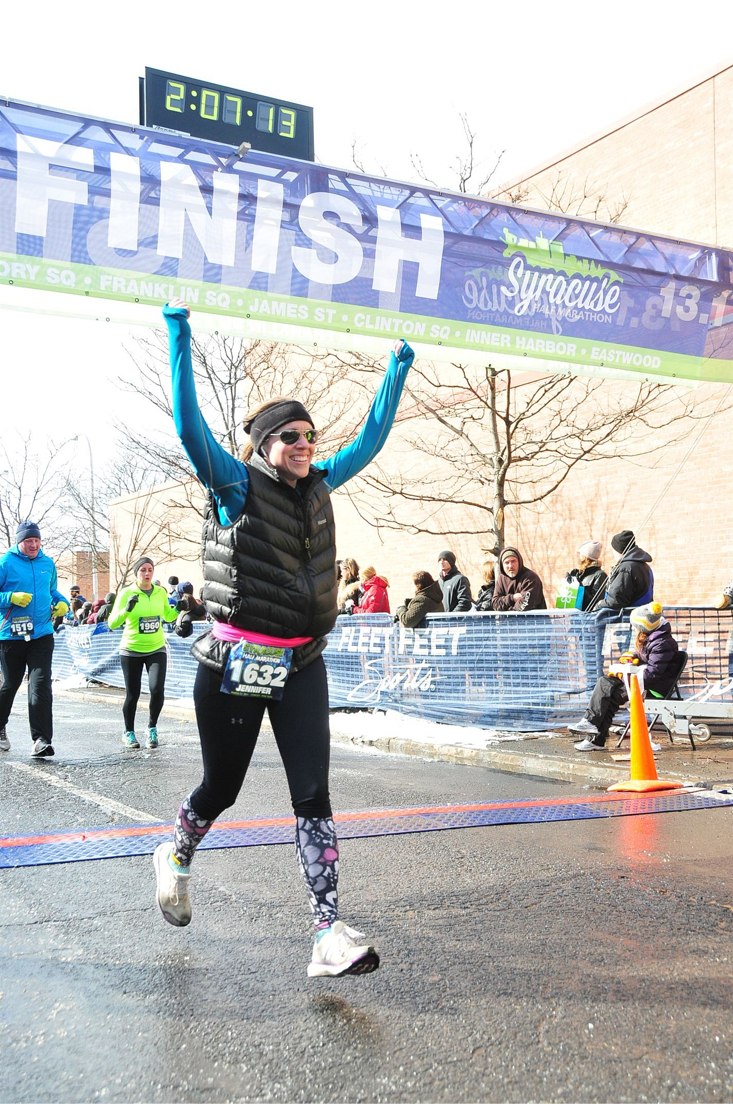 Crossing the finish line of the Syracuse Half Marathon with an official time of 2:05:45 - better than the goal time I trained for!