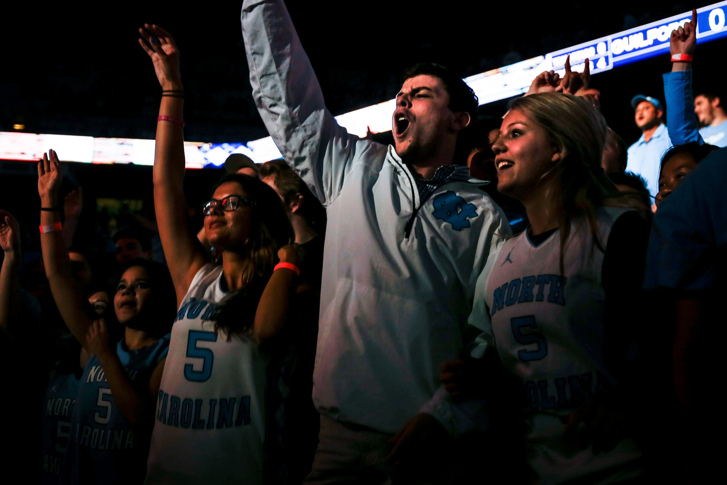 UNC fans cheer during the North Carolina team intoductions before their season's opening exhibition basketball game at the Dean Smith Center on Friday, Nov. 6, 2015. UNC defeated Guilford 99-49.