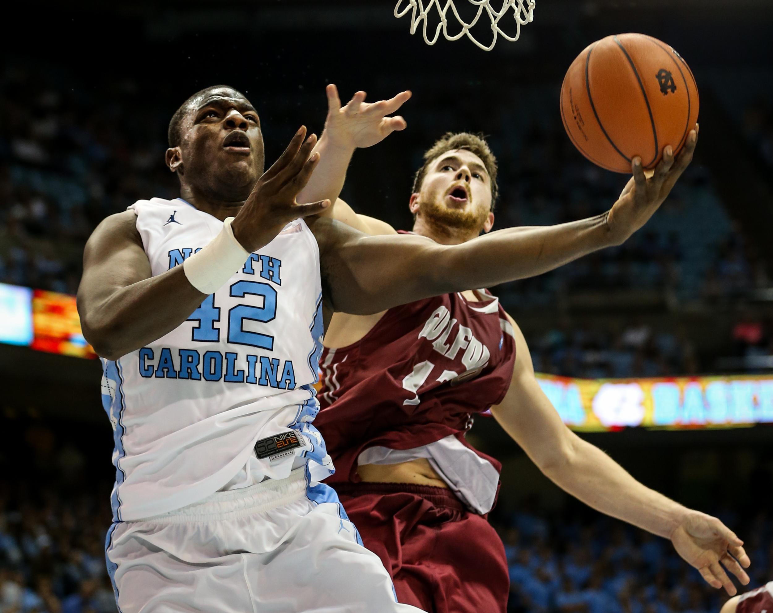 Joel James of the North Carolina Tarheels goes up for a layup as Will Freeman of Guilford attempts to block the shot during the men's preseason exhibition game at the Dean Smith Center on Friday, Nov. 6, 2015. UNC defeated Guilford 99-49.