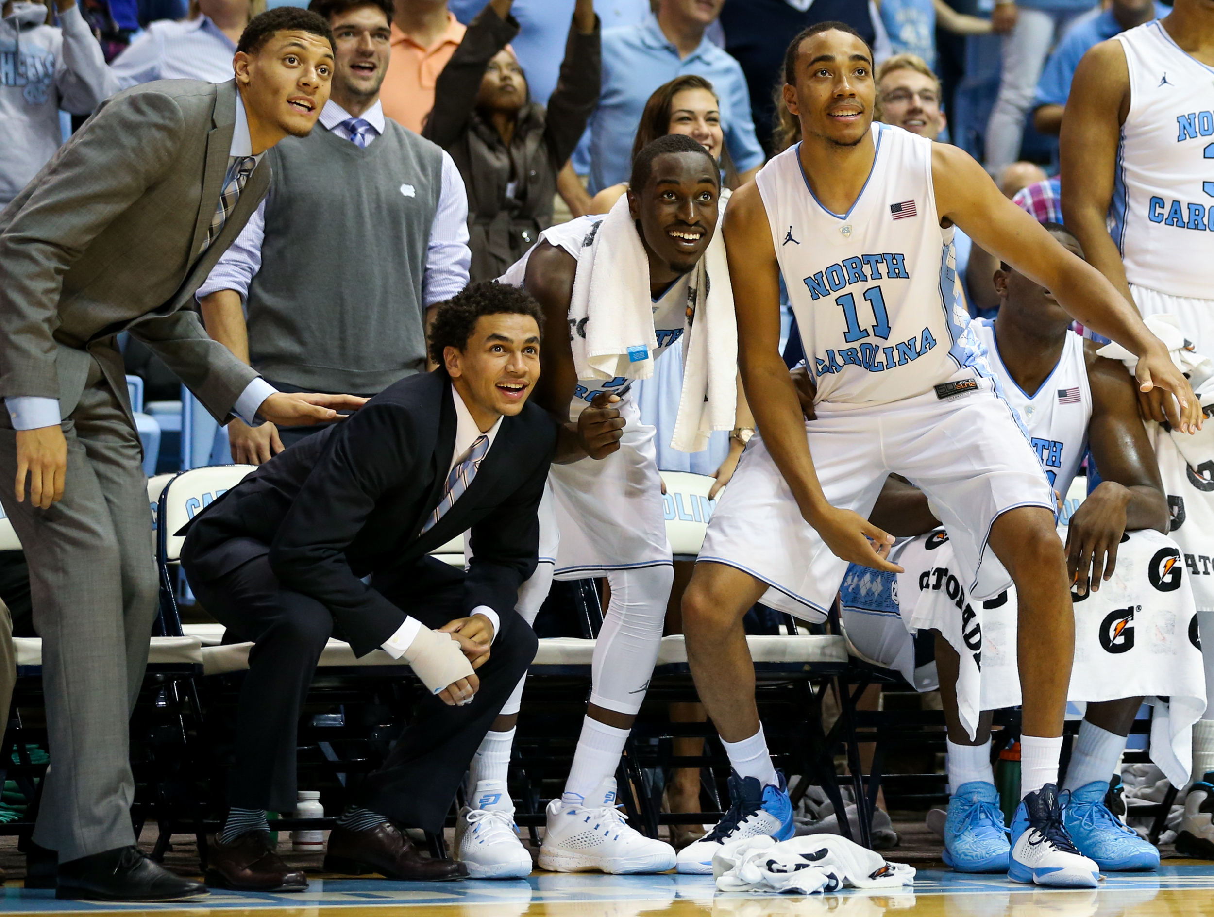 From left, Justin Jackson, Marcus Paige, Theo Pinson and Brice Johnson cheer from the bench during their exhibition game at the Dean Smith Center on Friday, Nov. 6, 2015. UNC defeated Guilford 99-49.