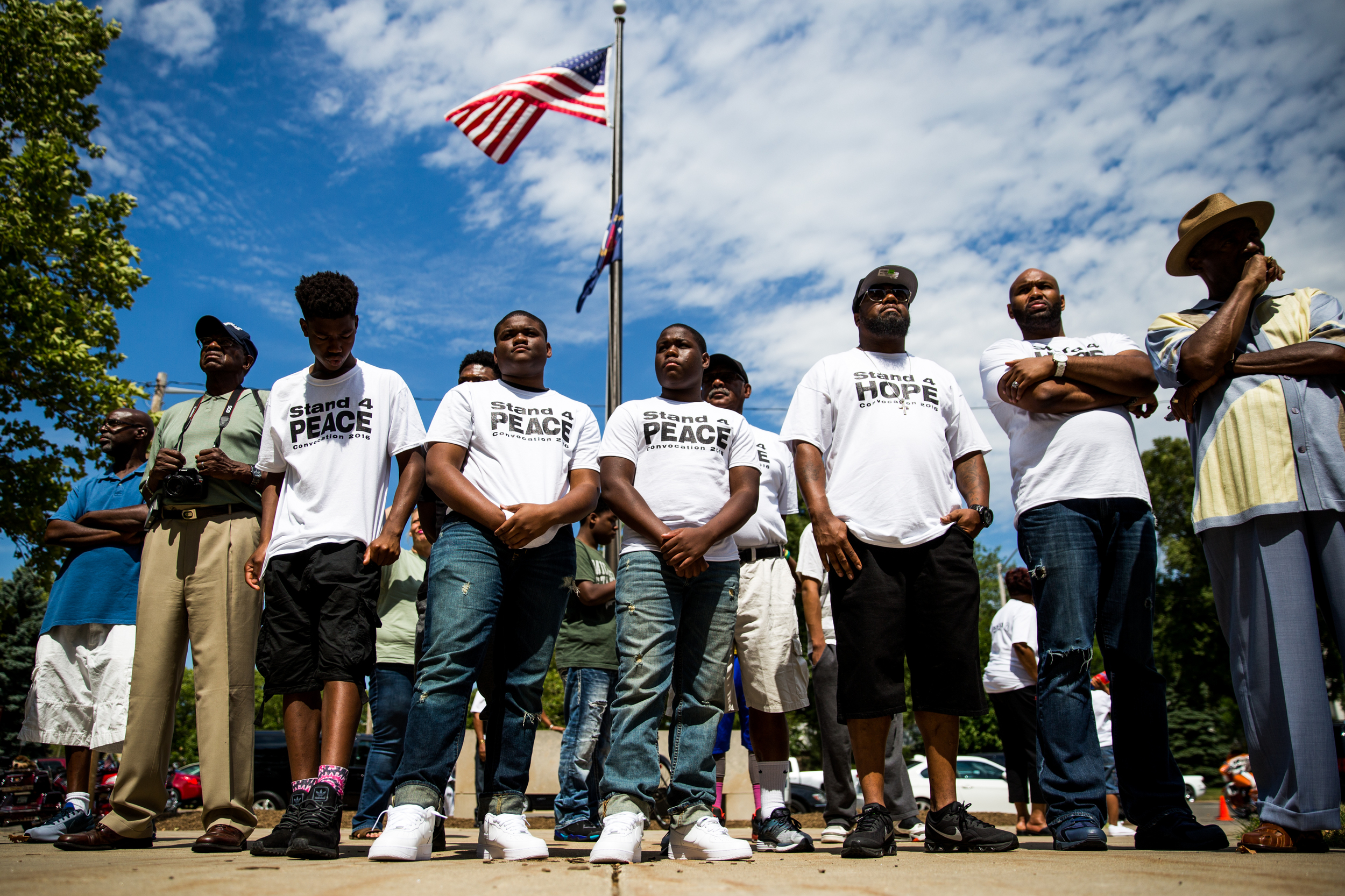 The community of Flint gathers with law enforcement officers outside the Genesee County Jail during a protest organized by Ebenezer Ministries on Sunday, July 17, 2016 in downtown Flint. The protest promoted unity and respect between the community and law enforcement officers after the Baton Rouge shooting that left three police officers dead.