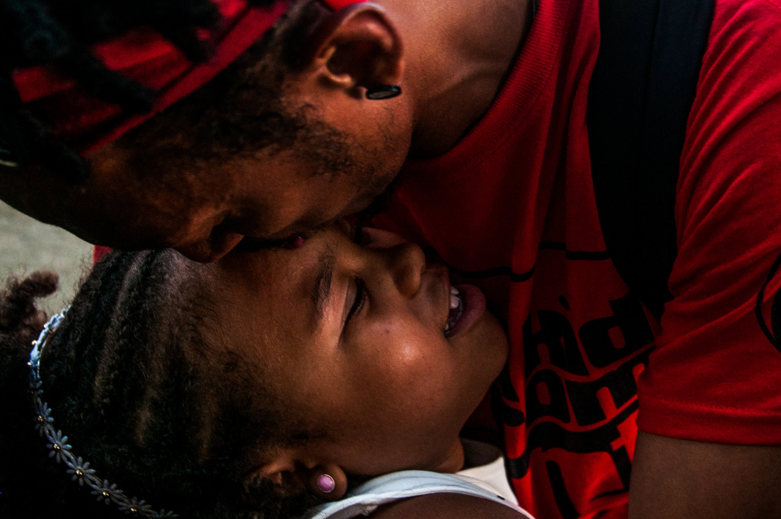 Gerald Barrett, of Flint, give Malaika Bradley, 7, of Flint, a kiss at the annual Flint Jazz Festival on Saturday, Aug. 13, 2016 in Flint.
