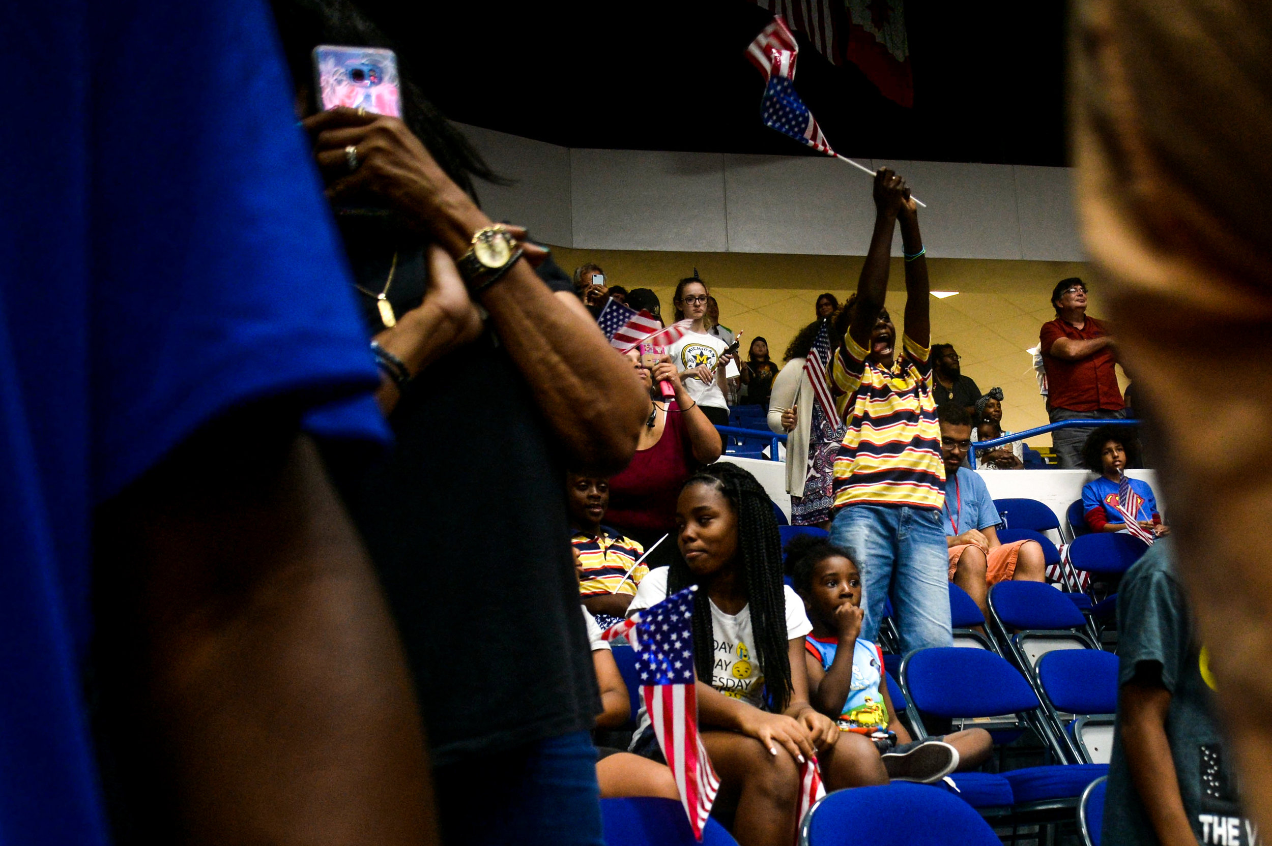 Romiel Williams, 11, of Flint, cheers during the Community-Wide Celebration for Claressa Shields on Thursday, Aug. 25, 2016 at the Dort Federal Event Center in Flint. Nearly 700 people gathered to hear Flint Boxer Claressa  Shields, the only American back-to-back Olympic gold medalist.