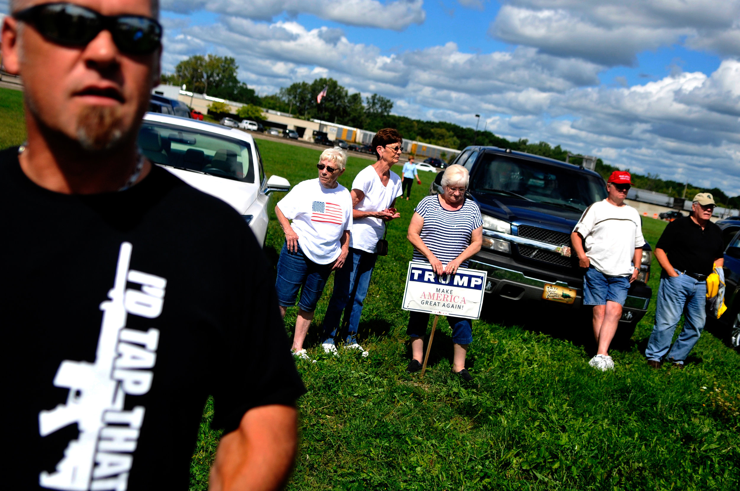 Dozens of people gather outside Bishop International Airport for the arrival of Republican presidential candidate Donald Trump on Wednesday, Sept. 14, 2016 in Flint.
