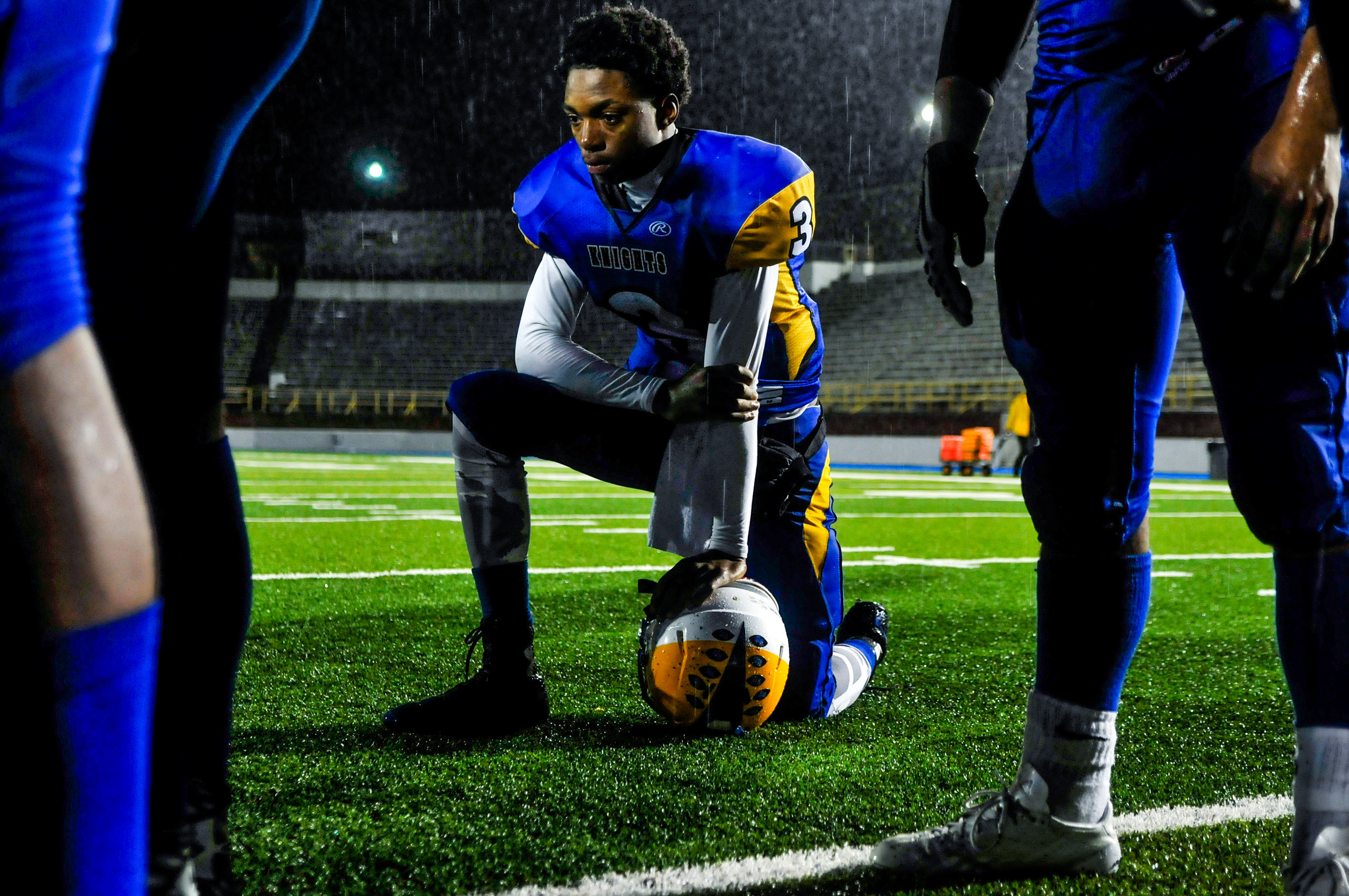 Flint Southwestern sophomore Zameer Wallace, No. 3,kneels while he listens to his coach after a tough loss in the final seconds of the game against Mount Pleasant High School on Friday, Sept. 30, 2016 at Kettering University's Atwood Stadium in Flint. Mt Pleasant beat Flint Southwestern 14-13.
