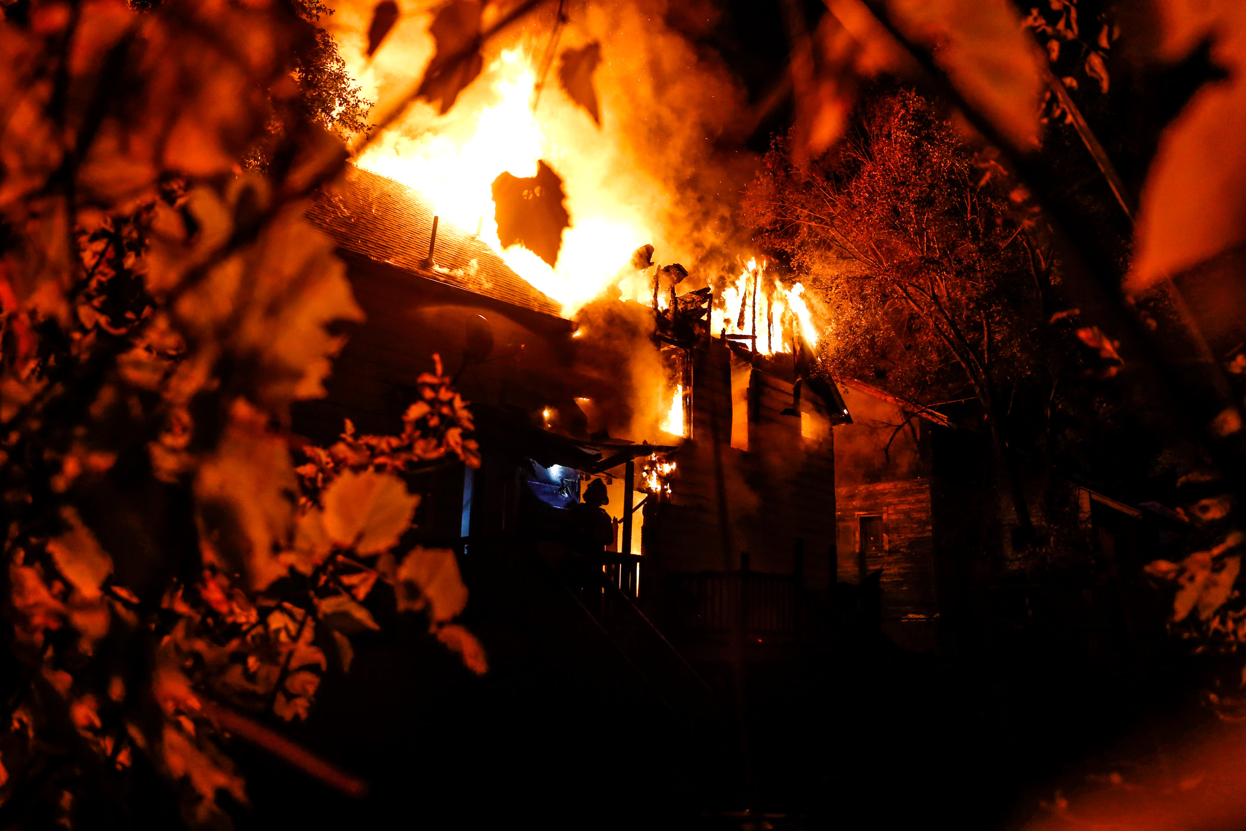 Flint firefighters and other emergency personnel respond to a vacant house fire during Devil's Night on Monday, Oct. 31, 2016 in Flint. Devil's Night received its name for its association with arson and other serious vandalism on the night before Halloween. In the late 1980s, the destruction peaked when hundreds of houses were destroyed in Detroit's inner-cities and surrounding areas.