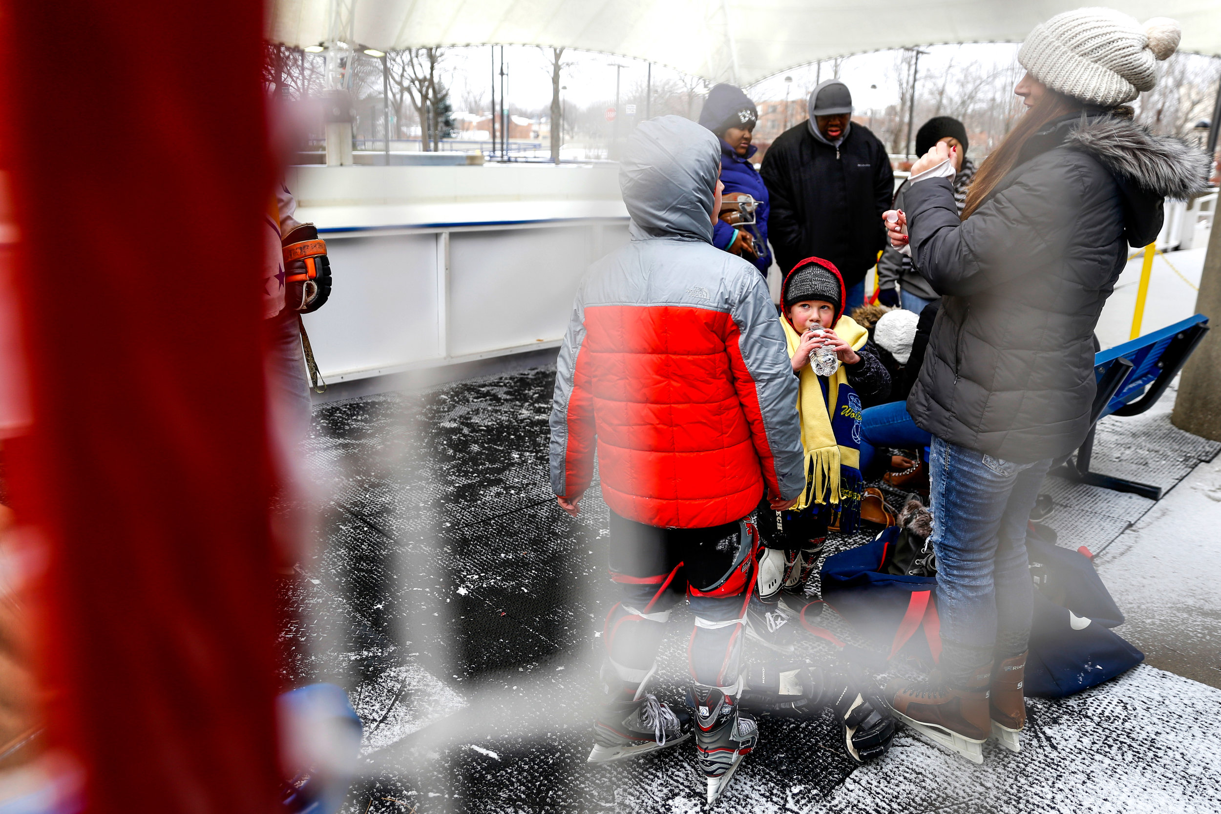 Eli Karrer, 4, of Flint, takes a break to drink water while ice skating on opening day of the free community open skate at UM-Flint Ice Rink on Saturday, Dec. 10, 2016 in downtown Flint. The rink is open Wednesdays, Fridays, Saturdays and Sundays weather permitting.