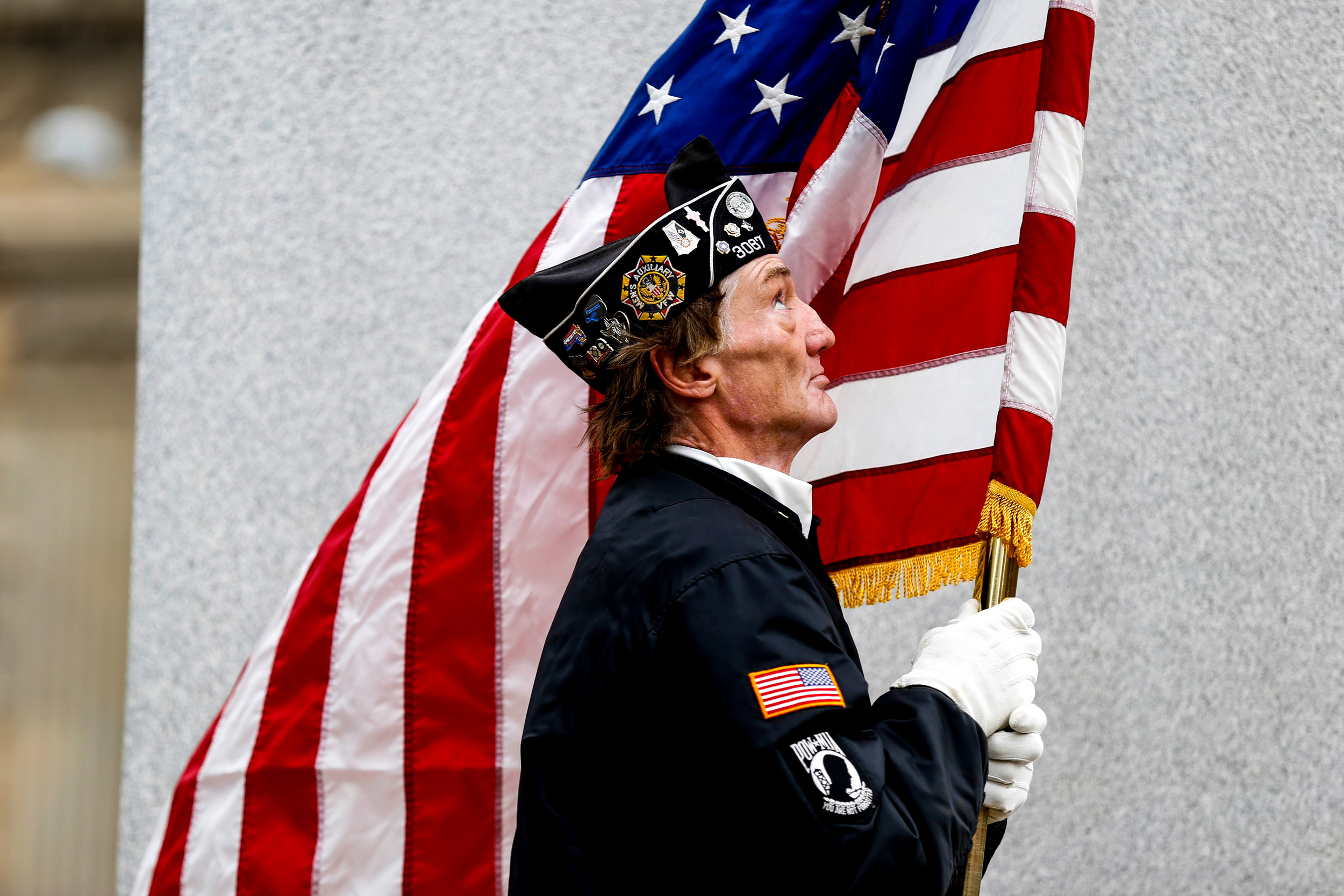 George Harris, with Post 3087, of Flint, holds the flag during a Veterans Day Salute honoring veterans and their service on Friday, Nov. 11, 2016 at McFarlan Veterans Memorial Park in downtown Flint.