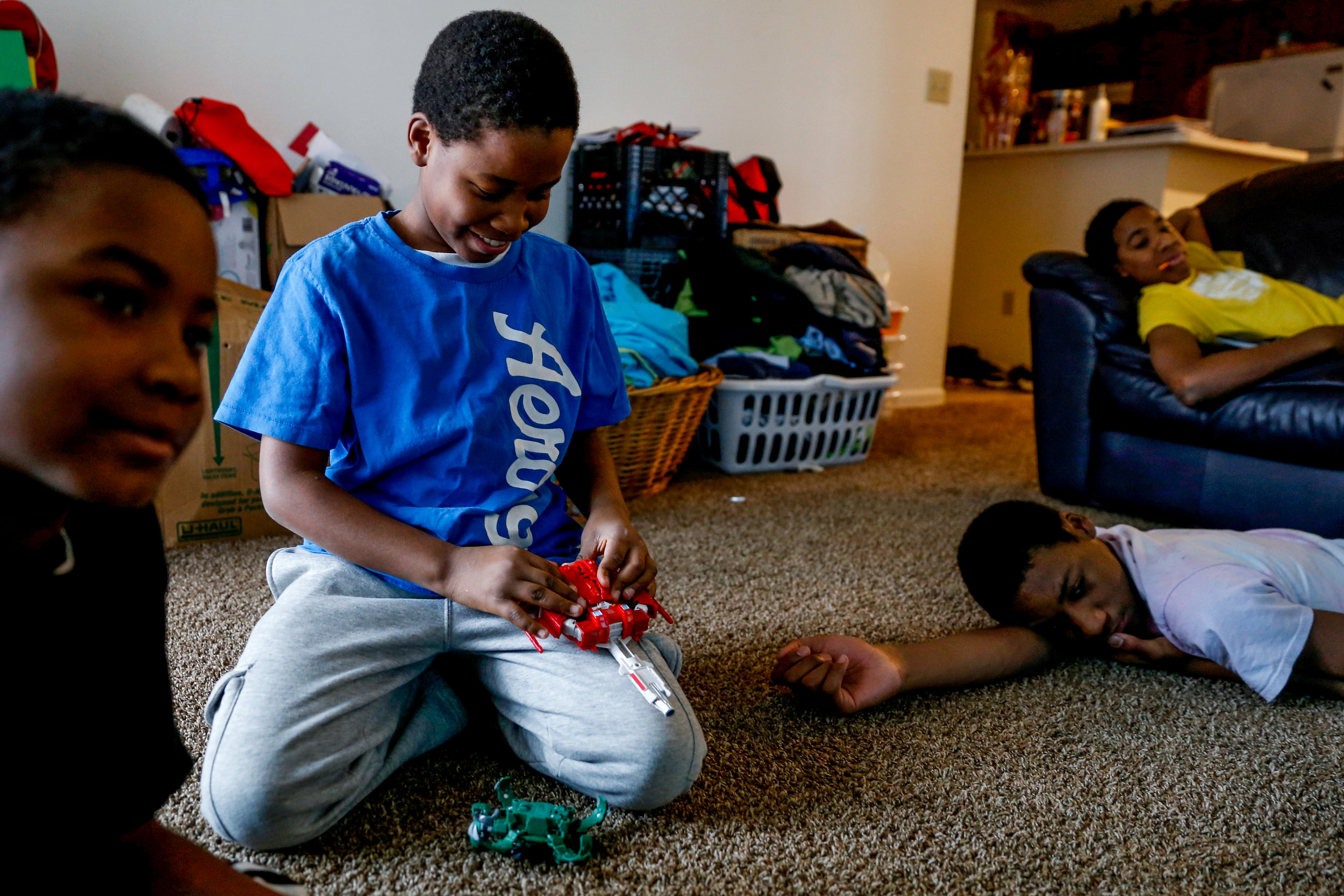 From left, Ray, 9, Jy'Aire, 13, Jordan, 7, and Jamairan, 11, watch television at their home on Friday, Dec. 30, 2016. Their mother, Aeisha Vann, 33, was reunited with her children after completing Baby Court in six months.