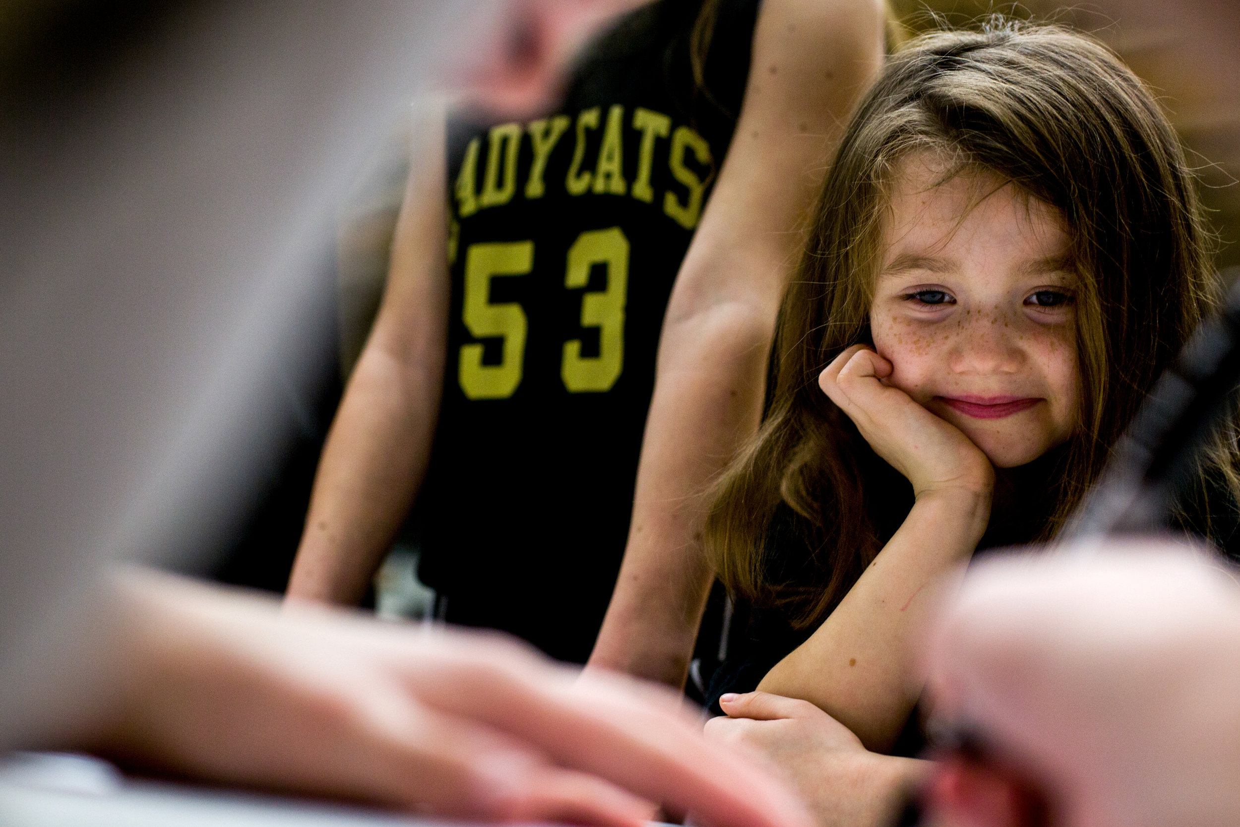 Taylor Underhill of Jasper, 6, watched as Jasper's Brooke Nottingham signed a girls basketball team poster for her after Saturday afternoon's basketball game at Jasper High School in Jasper. Jasper beat Mt. Vernon 62-25.