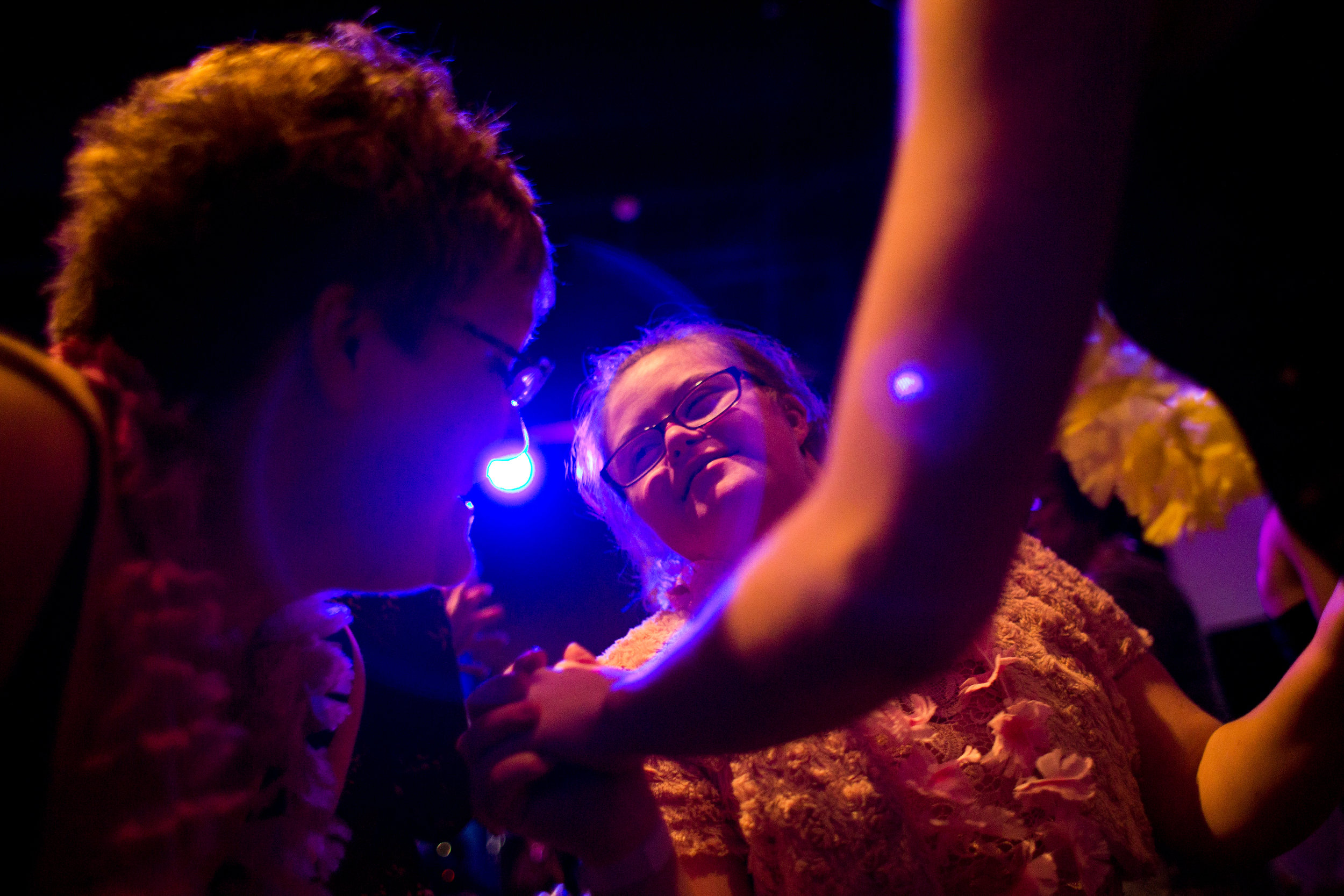 Juanita Overton of Dubois talked to Erin O'Neil while she danced with her longtime best friend Lydia Shepherd of Jasper during Friday night's Night to Shine event at Redemption Christian Church in Jasper. The Tim Tebow Foundation sponsored the prom-like event for children with special needs. The event included dinner, dancing, karaoke, a photo booth and shaved ice for attendees to enjoy.