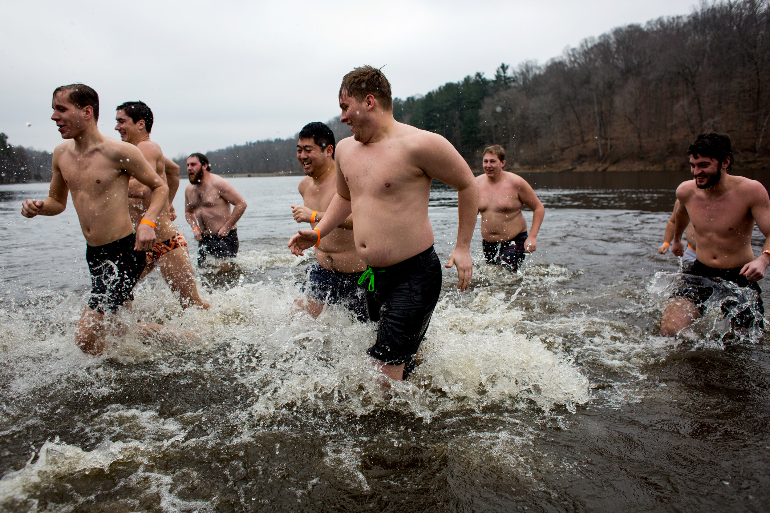 Participants ran back to shore after plunging into the frigid water during the annual plunge.