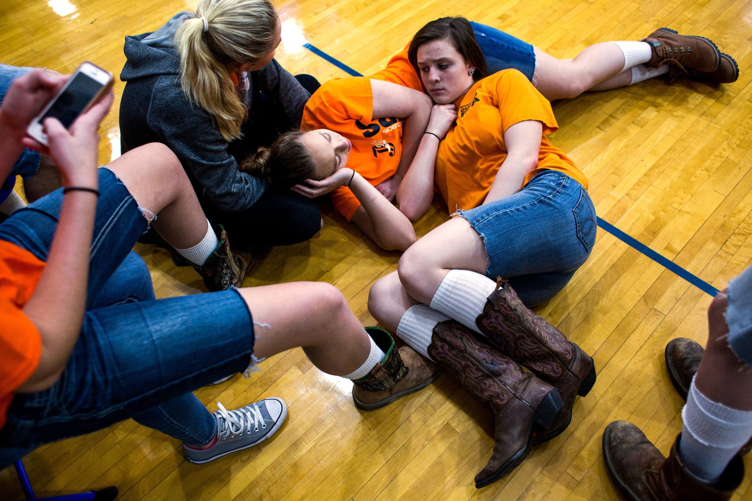 "Northeast Dubois freshman MaKena Everman, right, laid on top of freshman Fantasy Wright after lunch Thursday. As a way of remembering classmate Chad Knies who was killed recently in a car accident, the students wore orange shirts that match the color of his favorite tractor, cut-off jean shorts and high, white socks with boots or black tennis shoes which the students said he would always wear. ""He was just a really outgoing person,"" Everman said. ""Being such a small school...when you take one of us out, it takes us all out. We were all affected by what happened because he was so close to most people."""