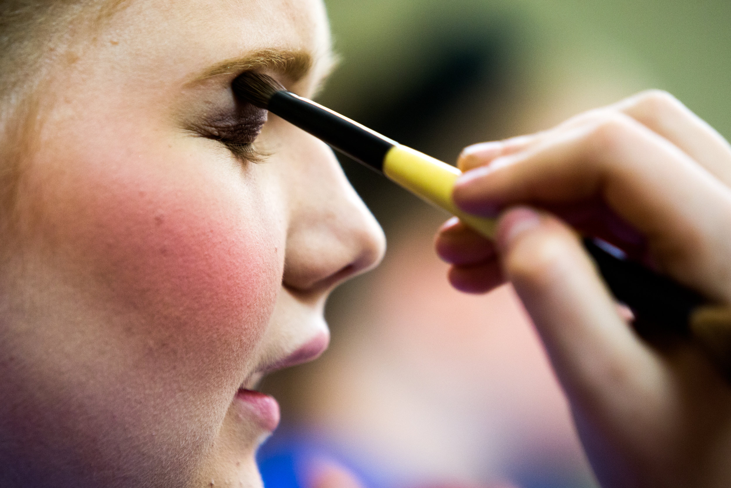 "Forest Park High School seniors Brianna Eckert blended the eyeshadow for Bailey Luttrell, left, during a rehearsal of ""Shrek the Musical"" on Tuesday at the school in Ferdinand. The musical will be performed 7:30 p.m. Friday and Saturday and at 2 p.m. Saturday and Sunday."