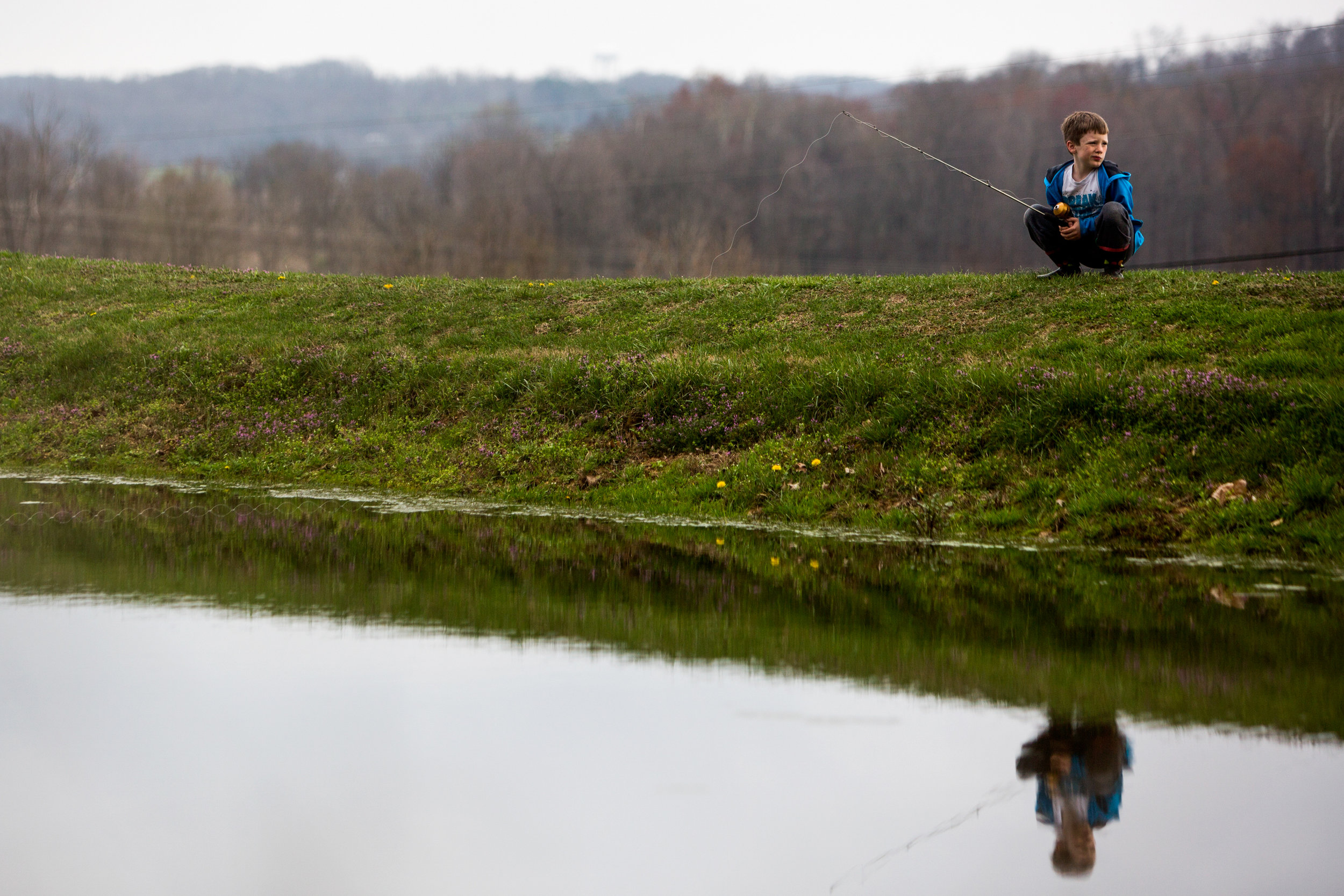 Marshall Schepers of Dubois, 8, waited for a bite while fishing at his grandmother's pond in Dubois on Tuesday during his spring break.