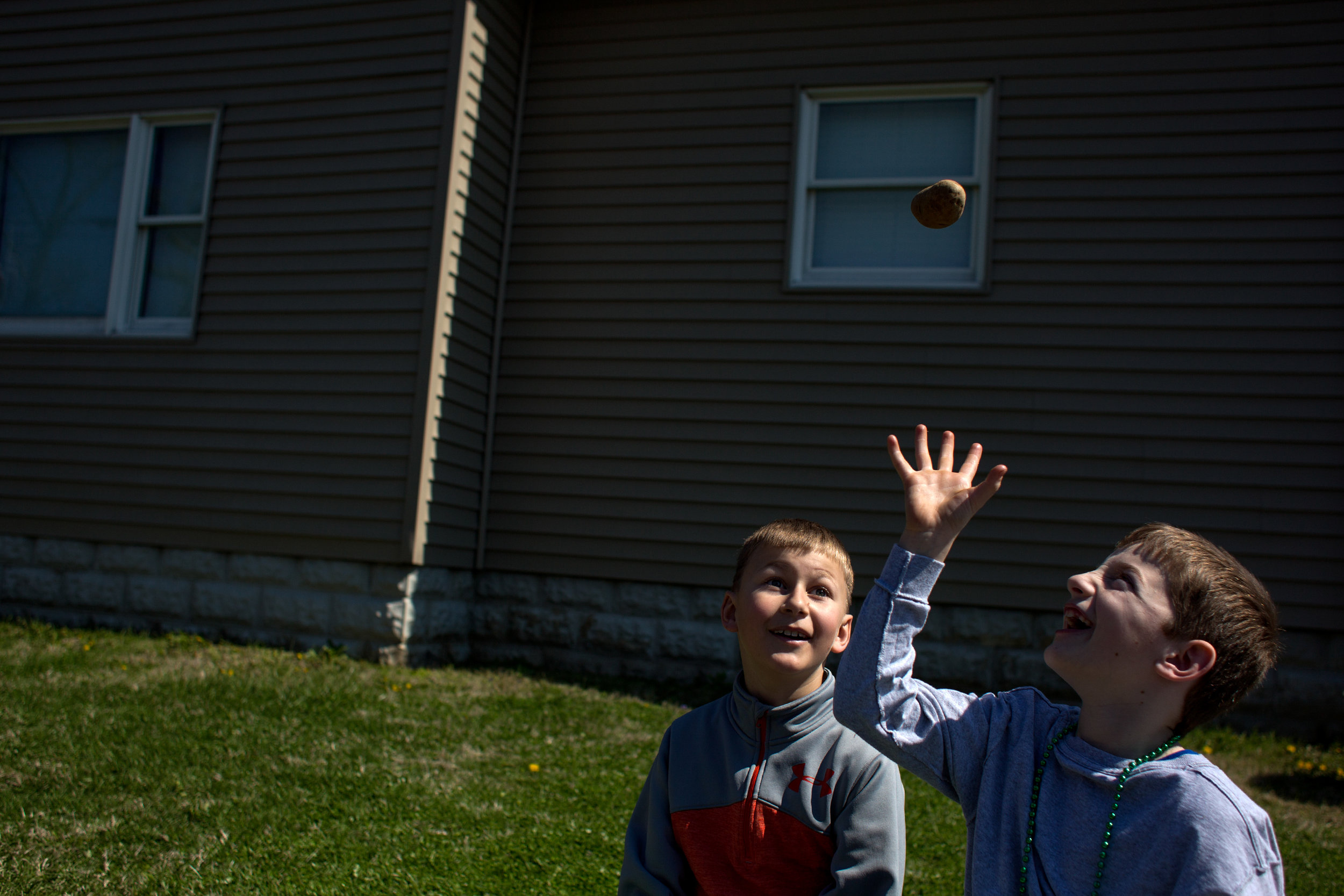 Aiden Ison, left, and Ethan Bauer, both 9 and of Jasper, tossed around a potato that they received during the parade at Ireland's annual St. Patrick's celebration on Sunday.
