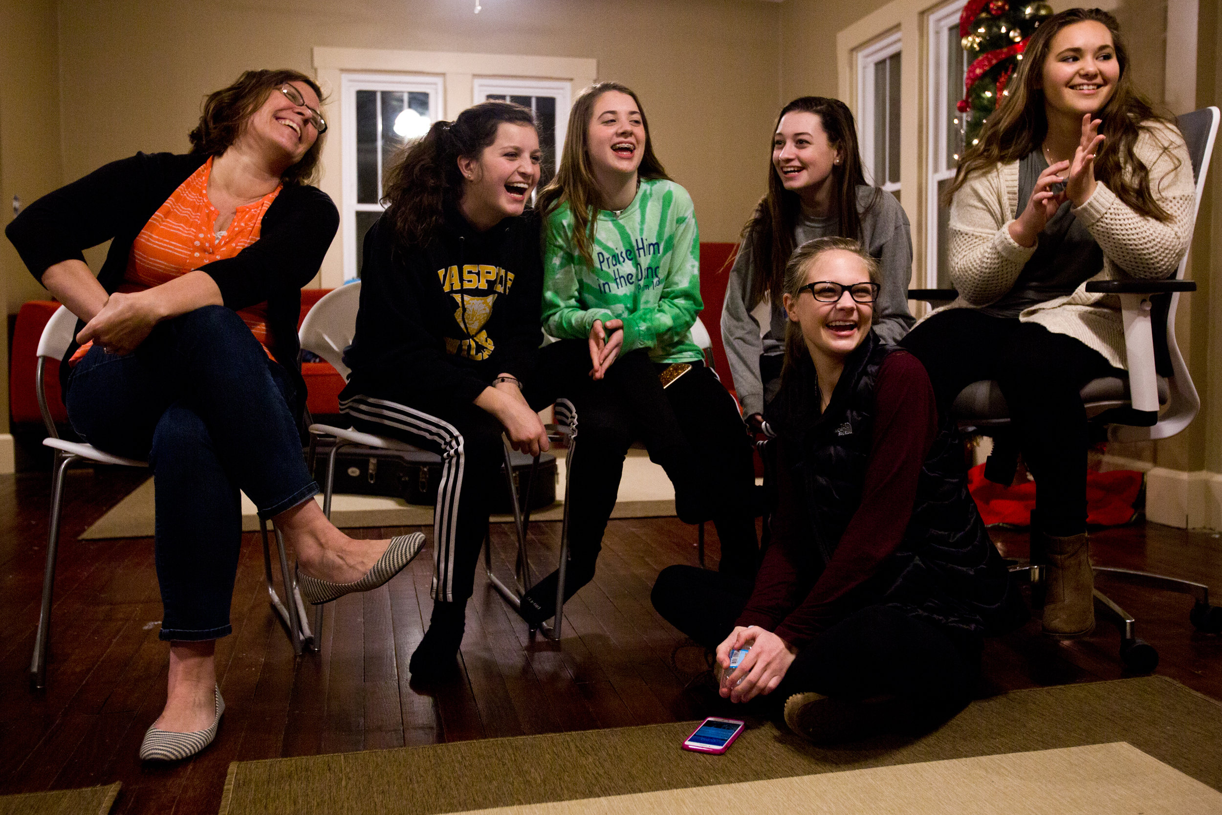 St. John Bosco Youth Ministry Director Angie Greulich, from left, Miah Bromm of Jasper, 15, Gemma Uebelhor of Ferdinand, 15, Chloe Lueken of Jasper, 17, Brianna Mehringer of Jasper, 16, and Madeline Springer of Jasper, 15, played a game during the ministry's Sunday evening gathering at the Bosco House in Jasper.Greulich led a group of high school-aged youth in putting together activities and a time of meditation to help them connect and grow.