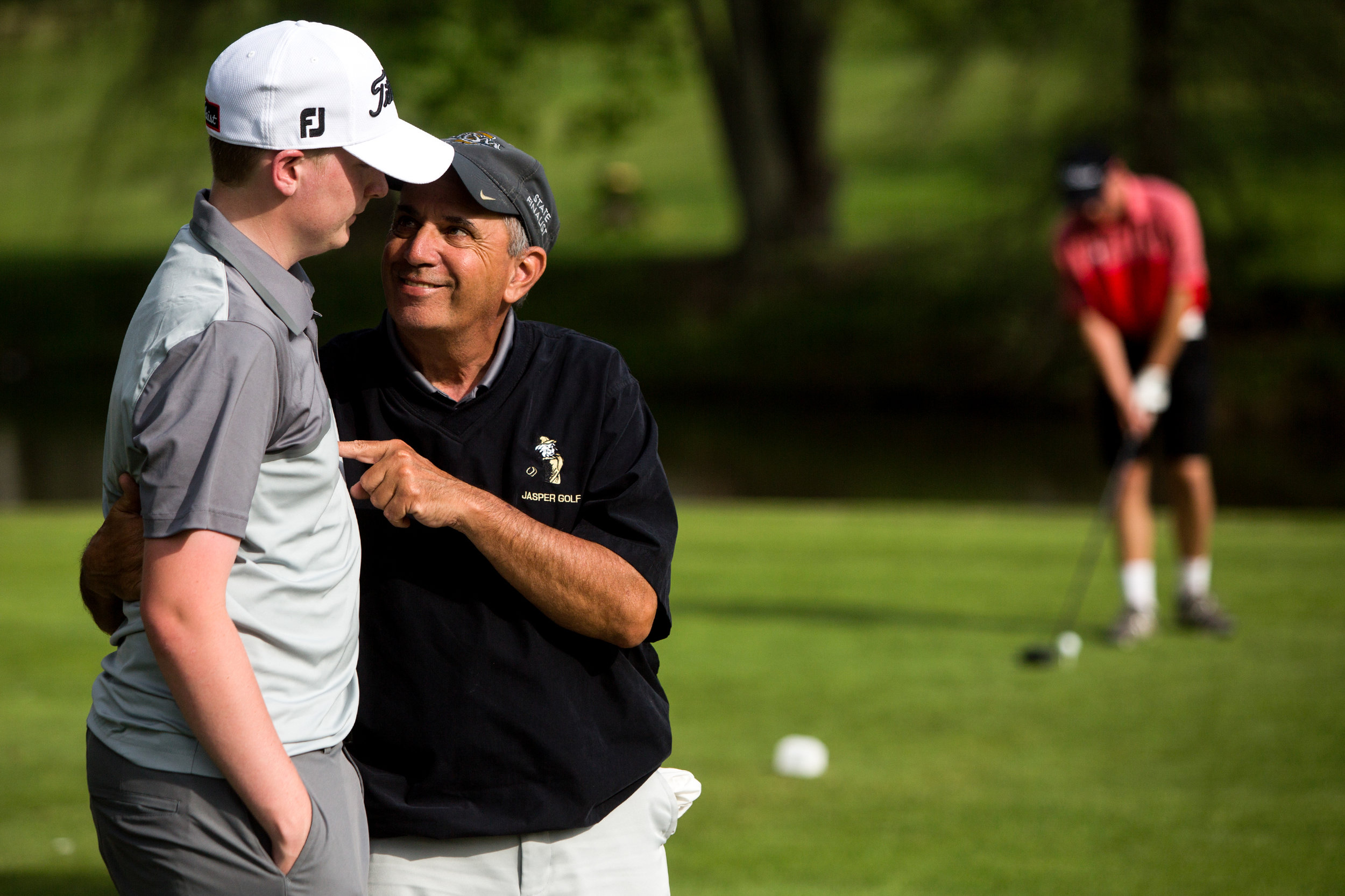 Jasper boys golf coach Steve Milligan, who talked to Evan Wolfe before he teed off during a match last week, is reveling in his return to the course this season. Milligan stepped away from coaching last spring while undergoing treatment for a form of brain cancer that also inhibited his ability to walk. With the cancer in remission and his energy restored, Milligan is back for his 12th season coaching the boys program.