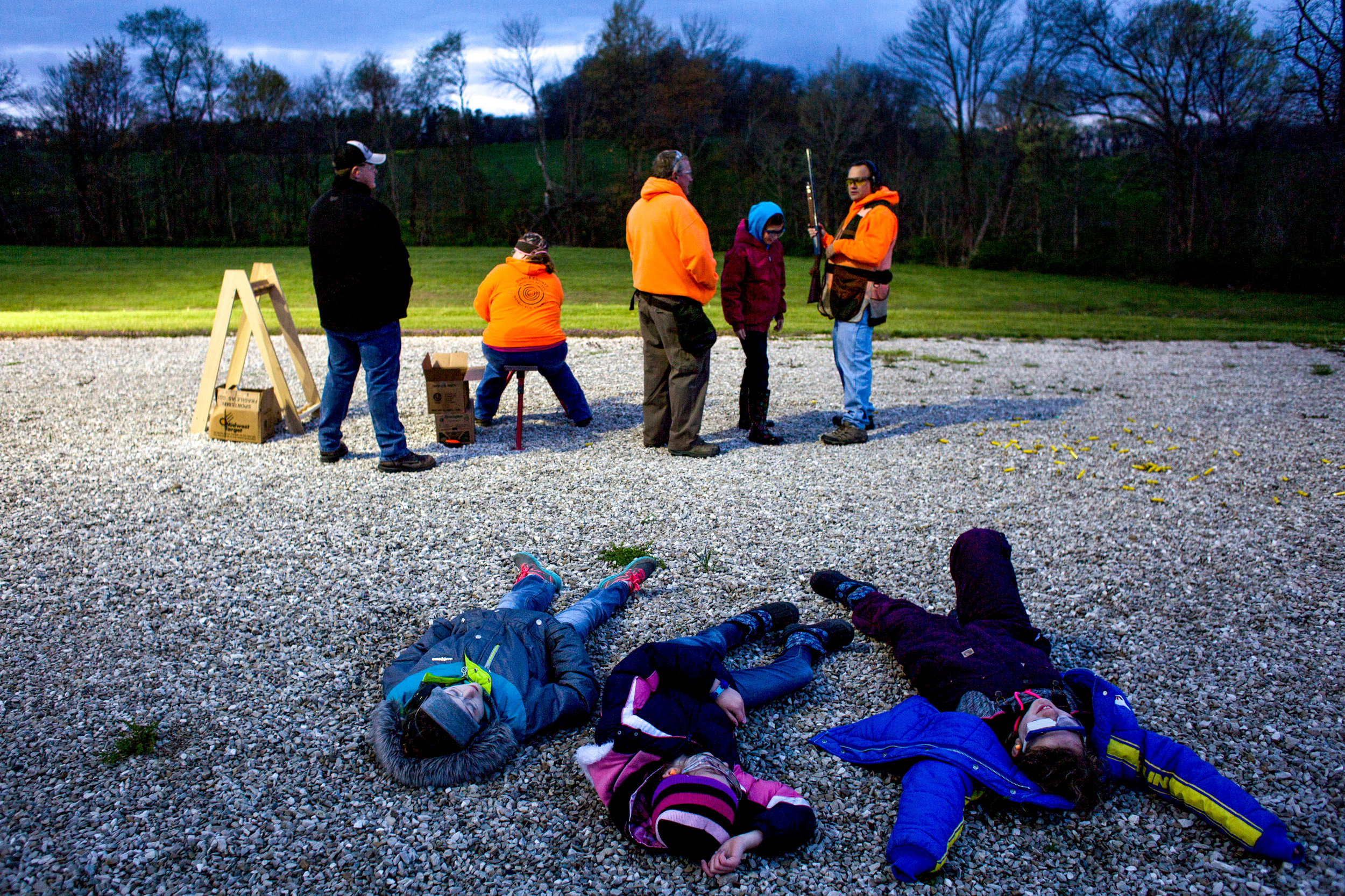 Ten-year-olds Lilly Knight of Jasper, left, Lillian Kuebler of Birdseye and Lydia Devillez of St. Anthony laid on the ground while Madelyn Miller of Birdseye practiced firing a shotgun during a Dubois County 4-H Shooting Sports meeting Thursday at the 4-H fairgrounds in Bretzville.