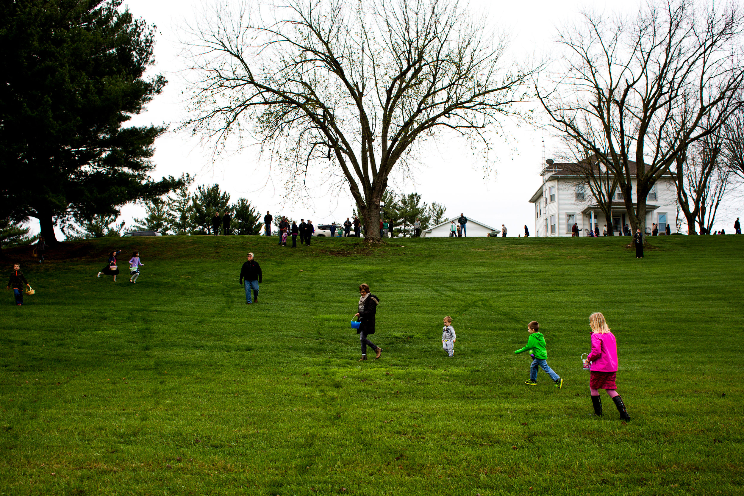 Children dashed along the hill outside St. Celestine Catholic Church as they searched for Easter eggs during the Easter egg hunt on Sunday.