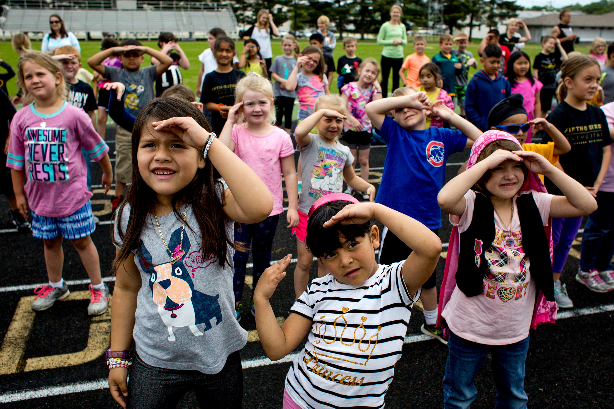 Fifth Street School kindergartners Samantha Escobar DeRenteria, left, Karina Salas Rodriguez and Ariel Page broke out their best moves Friday during a Zumba class as part of the closing ceremony of the Jasper school's annual Whiskers Walk. Families joined students throughout the day for the walk-a-thon around the track next door at Jerry Brewer Alumni Stadium.