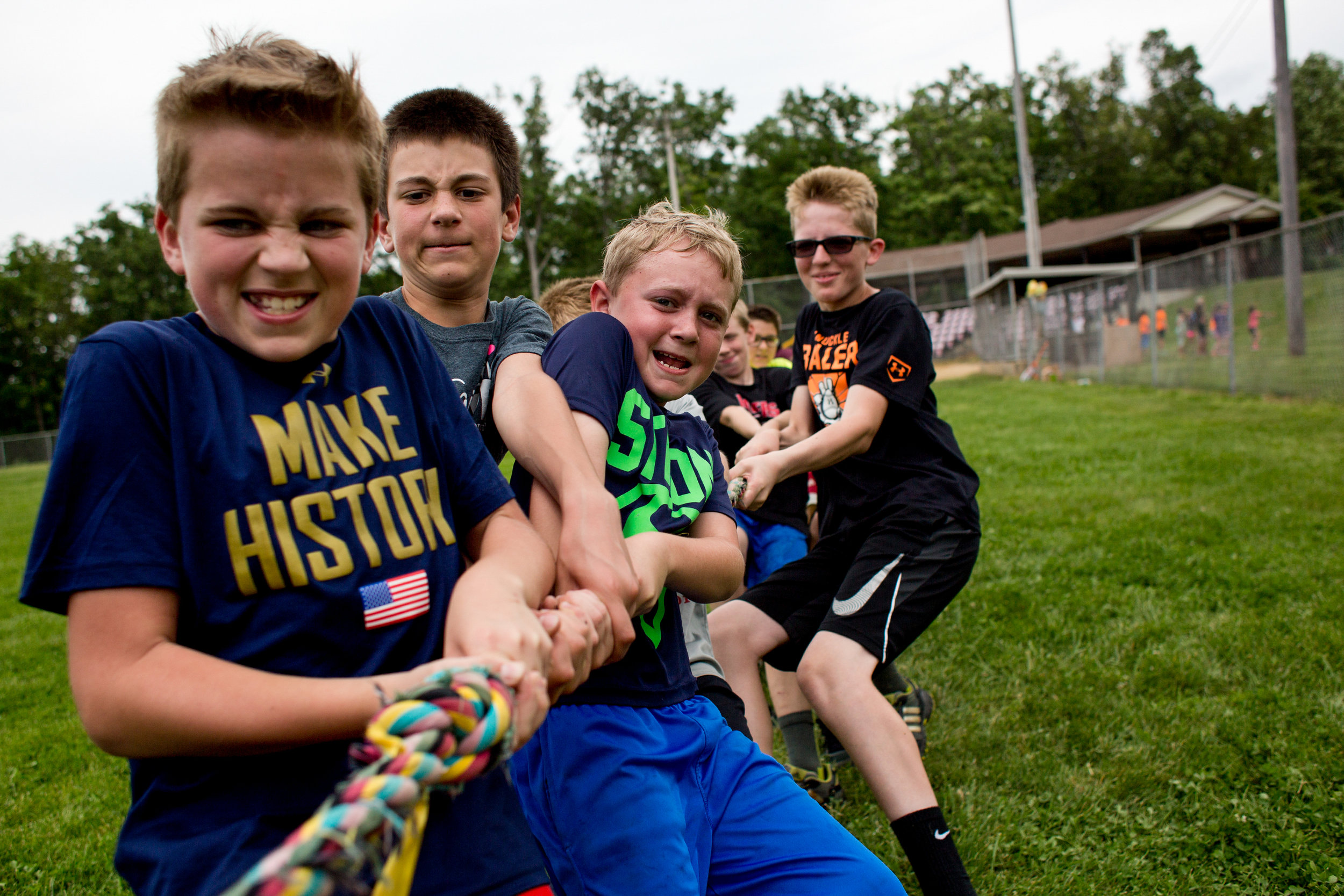 Holland Elementary School fifth-grade boys Jared Voegerl, from left, Kamren Neukam, Beau Schmitt and Keaton Allen competed in tug of war against the fifth-grade girls during the school's field day Wednesday at Holland Park. Different grades organized into teams to compete in various activities from tug of war to three-legged races.