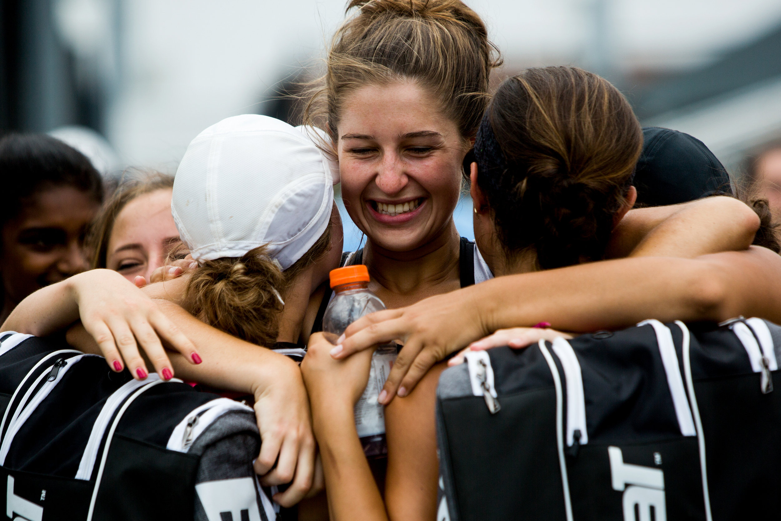 Jasper's Mallory Ahlbrand hugged teammates Jillian Seger, right, and Kathleen Messmer after they won their No. 2 doubles match during the semistate tennis match on Saturday in Jasper. The Wildcats dumped Evansville Memorial 4-1 for a semistate title - it's third straight state finals berth for the Wildcats.