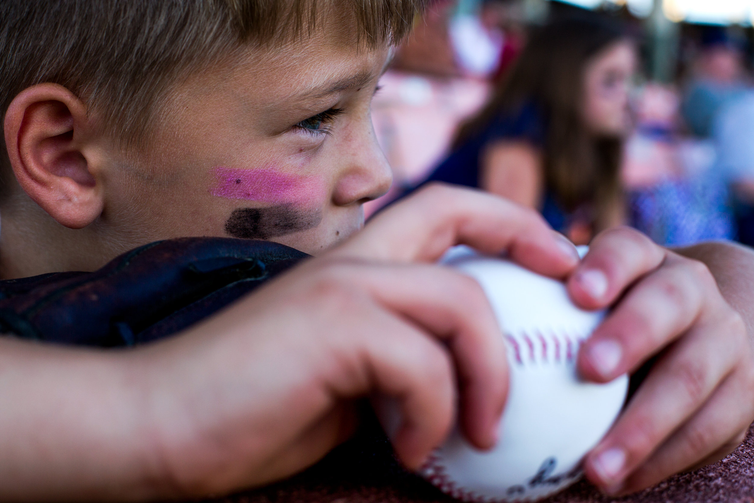 Elijah Dickey of French Lick, 8, held onto his signed baseball as he watched Tuesday night's game at League Stadium in Huntingburg. The Bombers defeated Paducah 8-2.