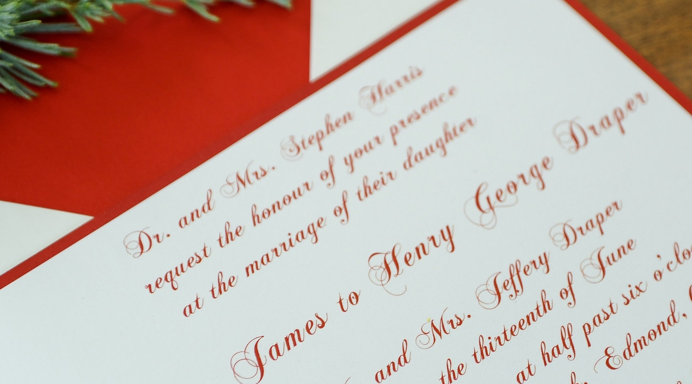 "This formal modern winter wedding invitation uses ""honour"" on the request line."