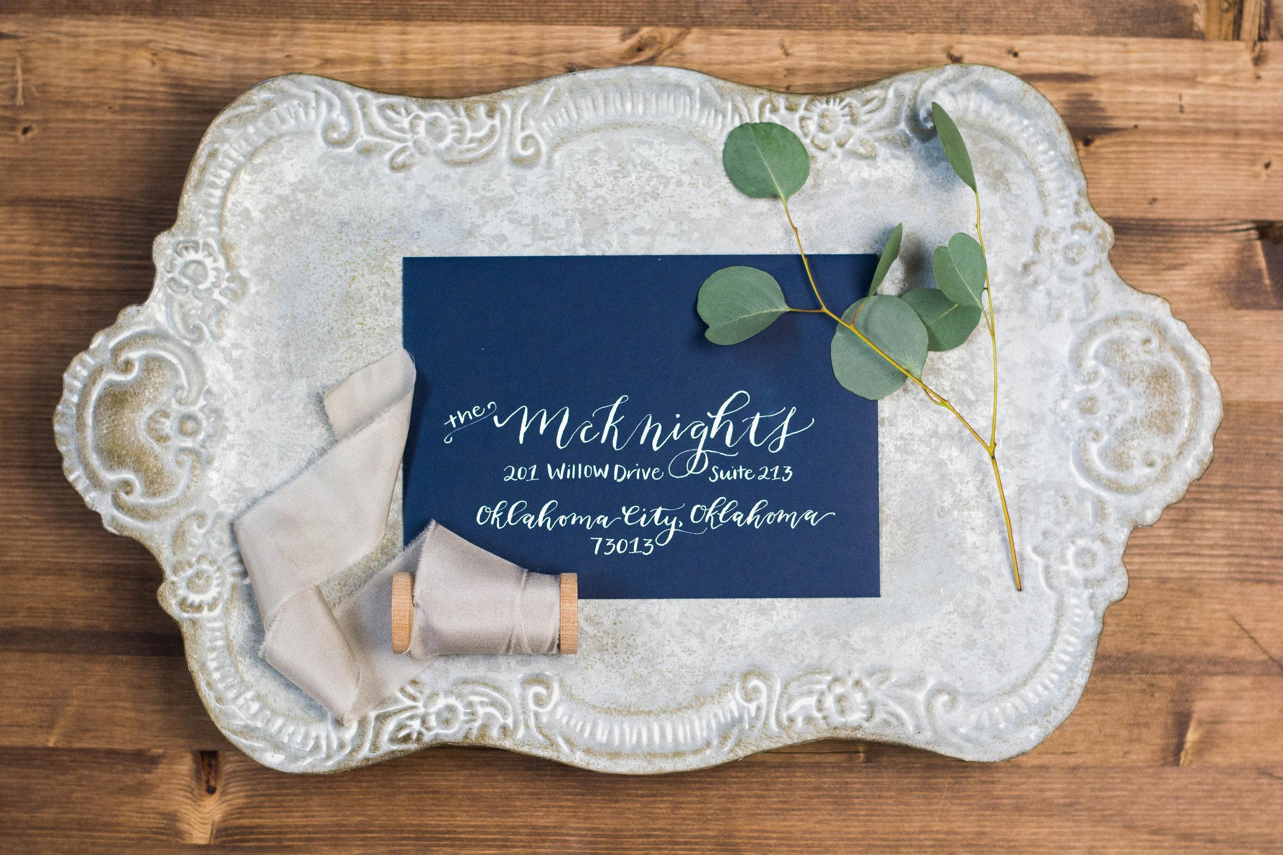 Modern White Wedding Calligraphy on Navy Envelope