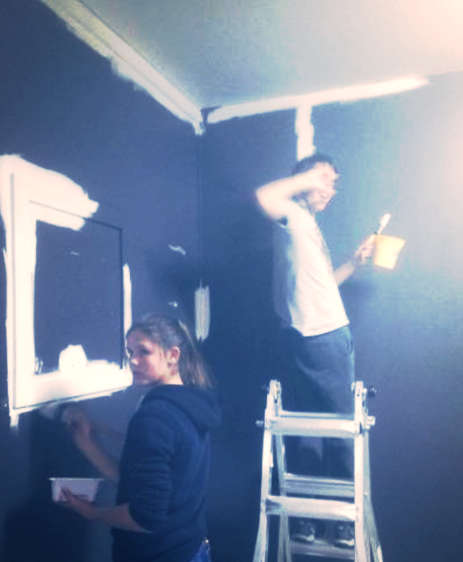 Youth re-painting a room for our Kids' Ministry to use as a cool- down space for children with special needs.