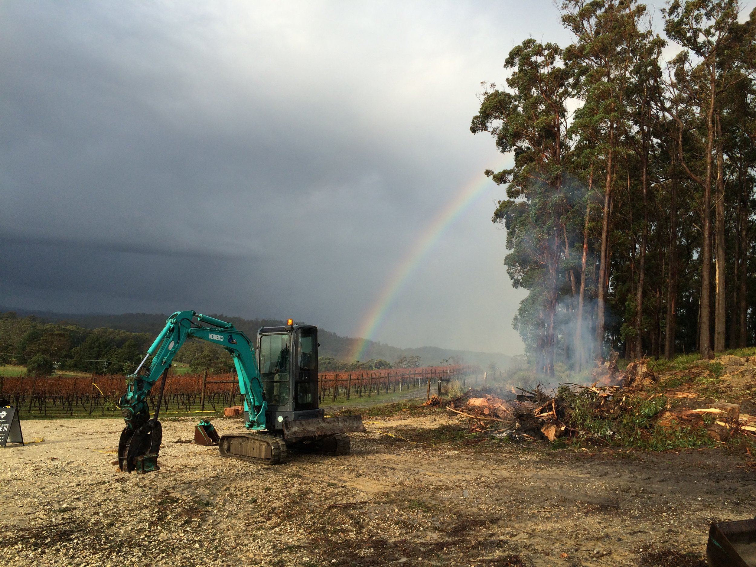 Digger with rainbow