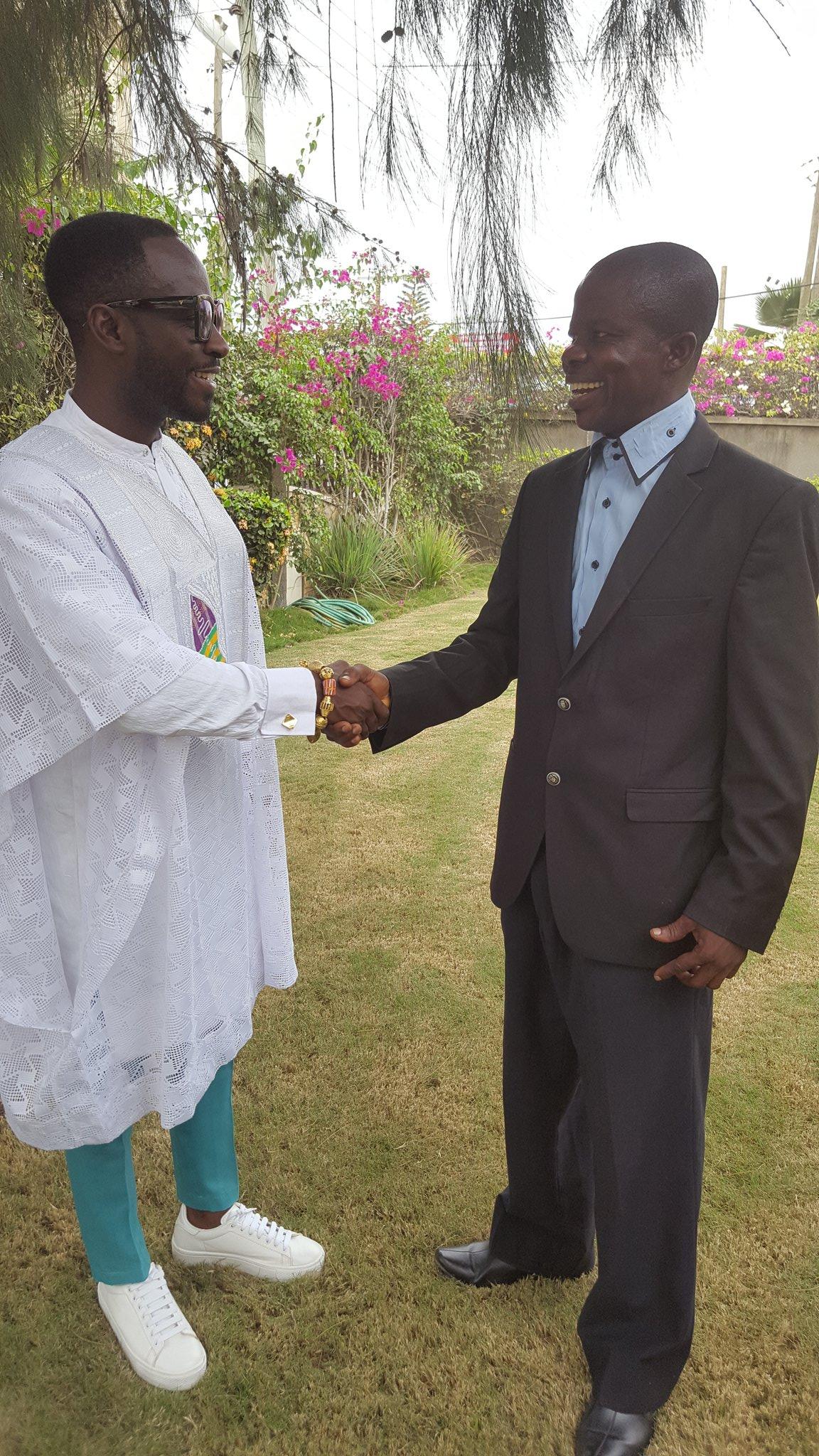 Ghanaian musician Okyeame Kwame (left) being greeted by DGM Ghana National Steering Committee Chairman Hayford Duodu (right); Credit: Hayford Duodu, DGM Ghana