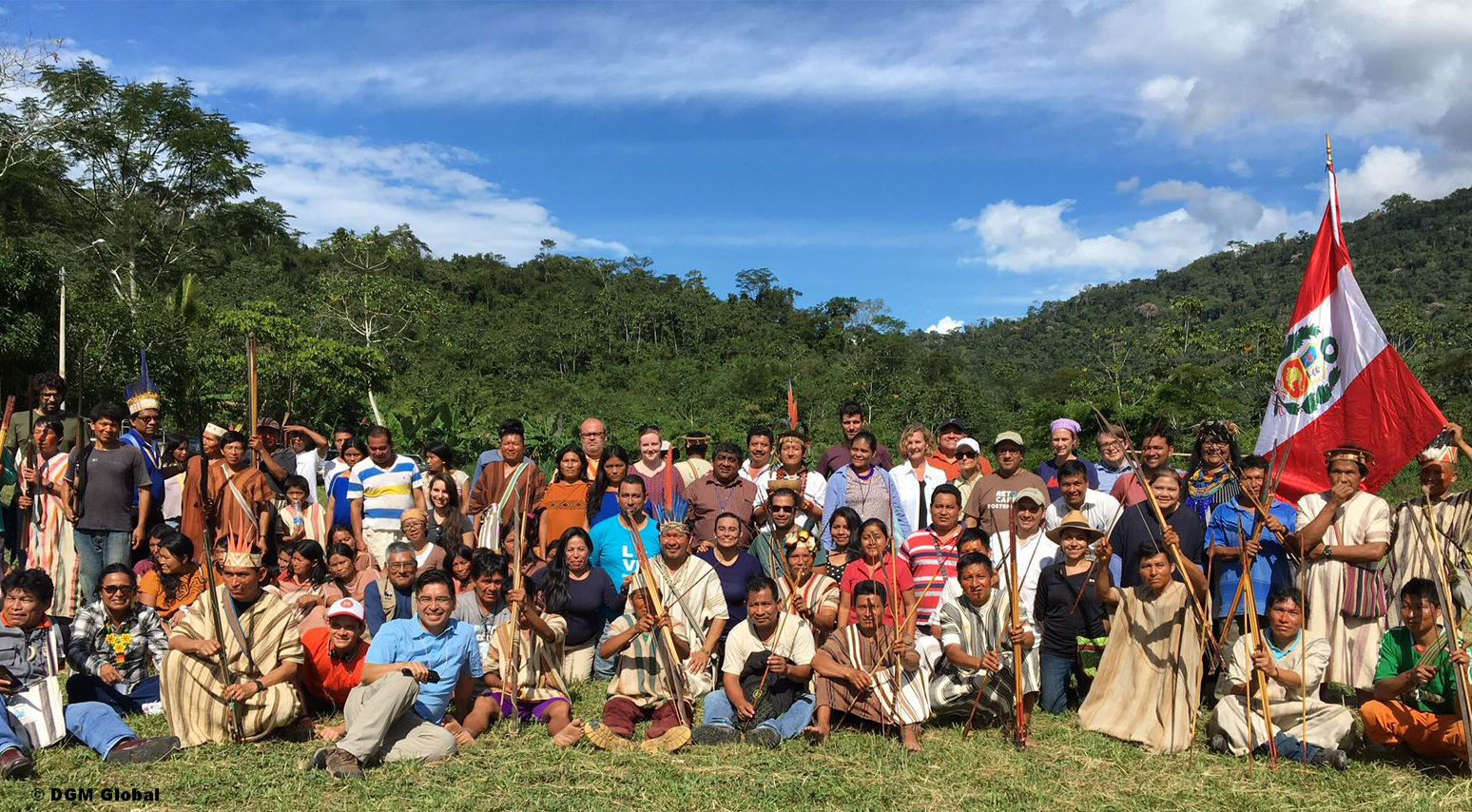Exchange participants posing for a group photo with members of the Palomar native community