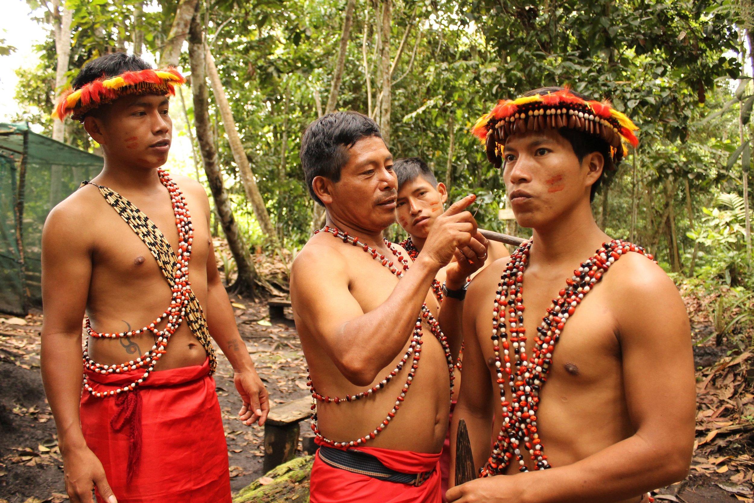 © Ana Yi Awajun men wearing their traditional attire.
