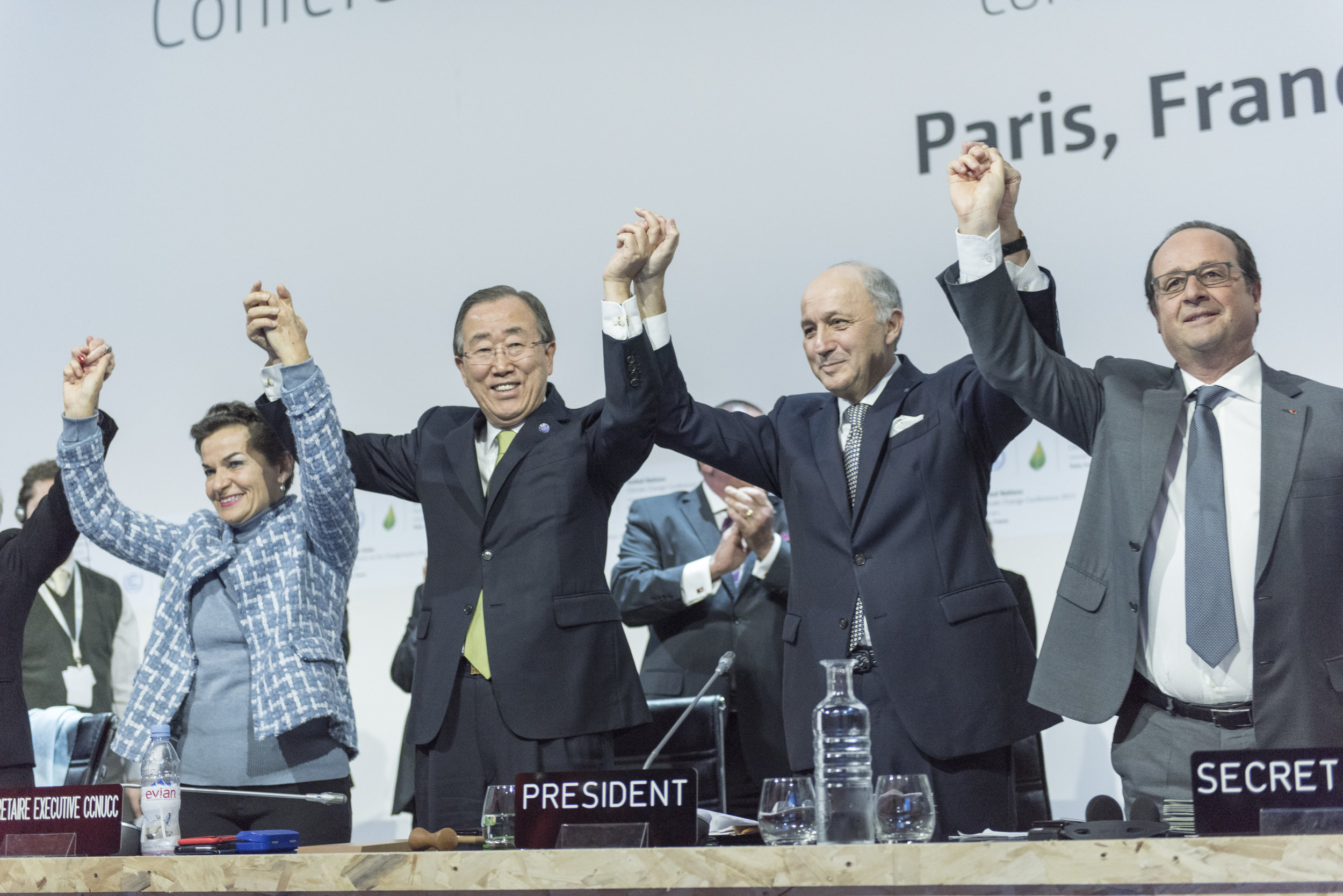 Celebration of historic adoption of Paris Agreement on climate change in 2015. Left to Right: Secretary-General Ban Ki-moon (second left); Christiana Figueres (left), Executive Secretary of the UN Framework Convention on Climate Change (UNFCCC); Laurent Fabius (second right), Minister for Foreign Affairs of France and President of the UN Climate Change Conference in Paris (COP21) and François Hollande (right), President of France celebrate after the historic adoption of Paris Agreement on climate change. Photo by: UN Photo/Mark Garten/Flickr Creative Commons