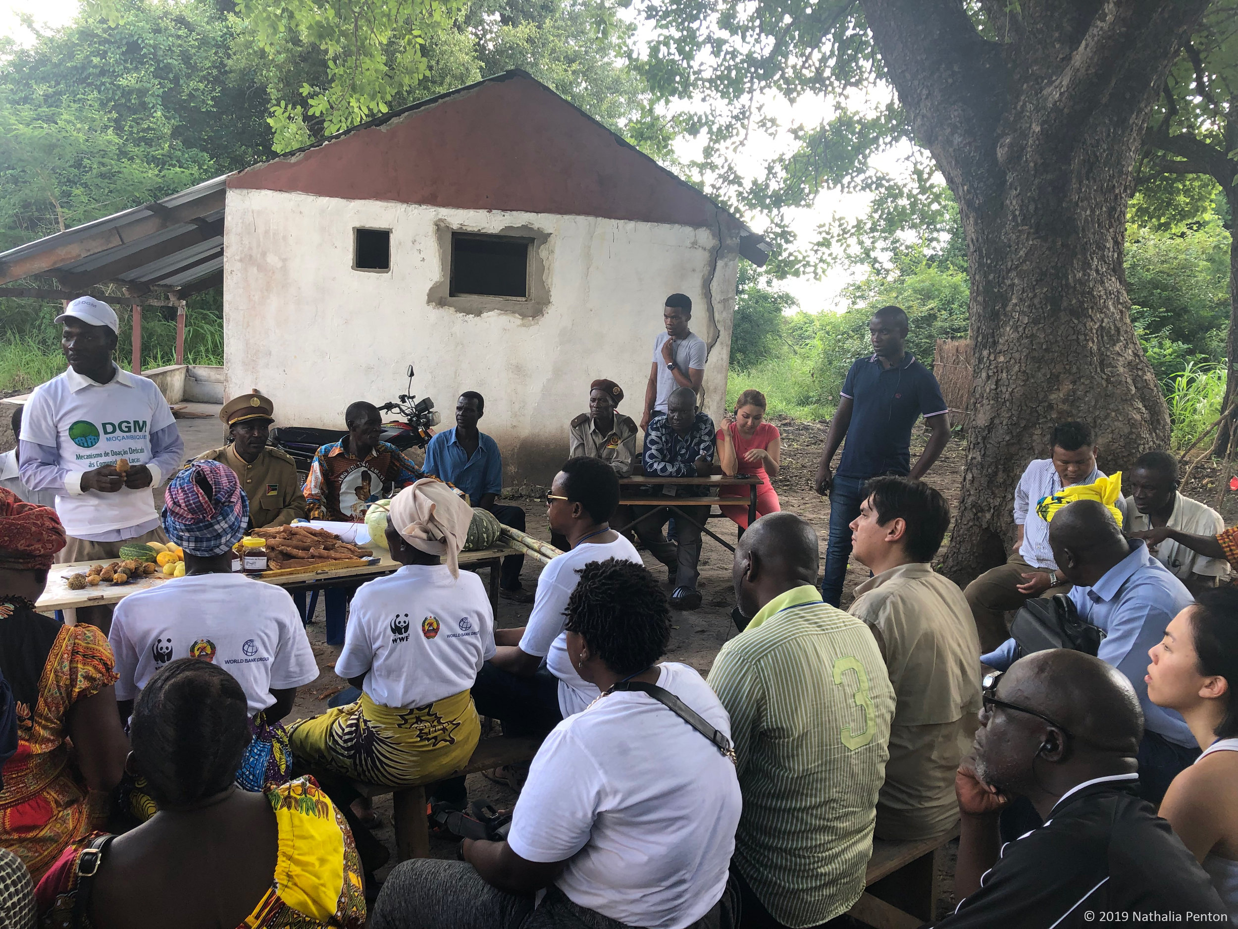 Exchange participants gather at the local community in Catapu, Mozambique to learn about the trainings, private partnerships, and ranger procedures the local people have set in place to protect and grow their land and livelihood.