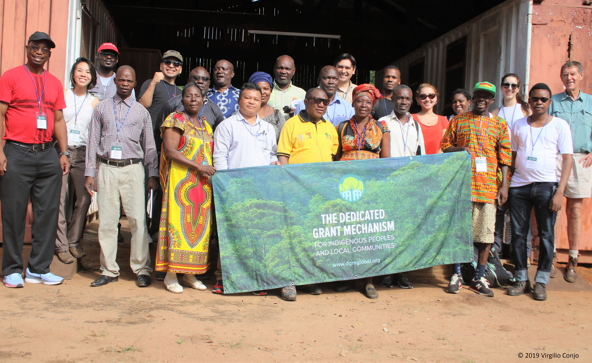 Participants of the DGM 2019 Africa Regional Exchange gather for a photo in front of the Environmental School building located in the forest concession managed by TCT Dalmann in Catapu, Mozambique.