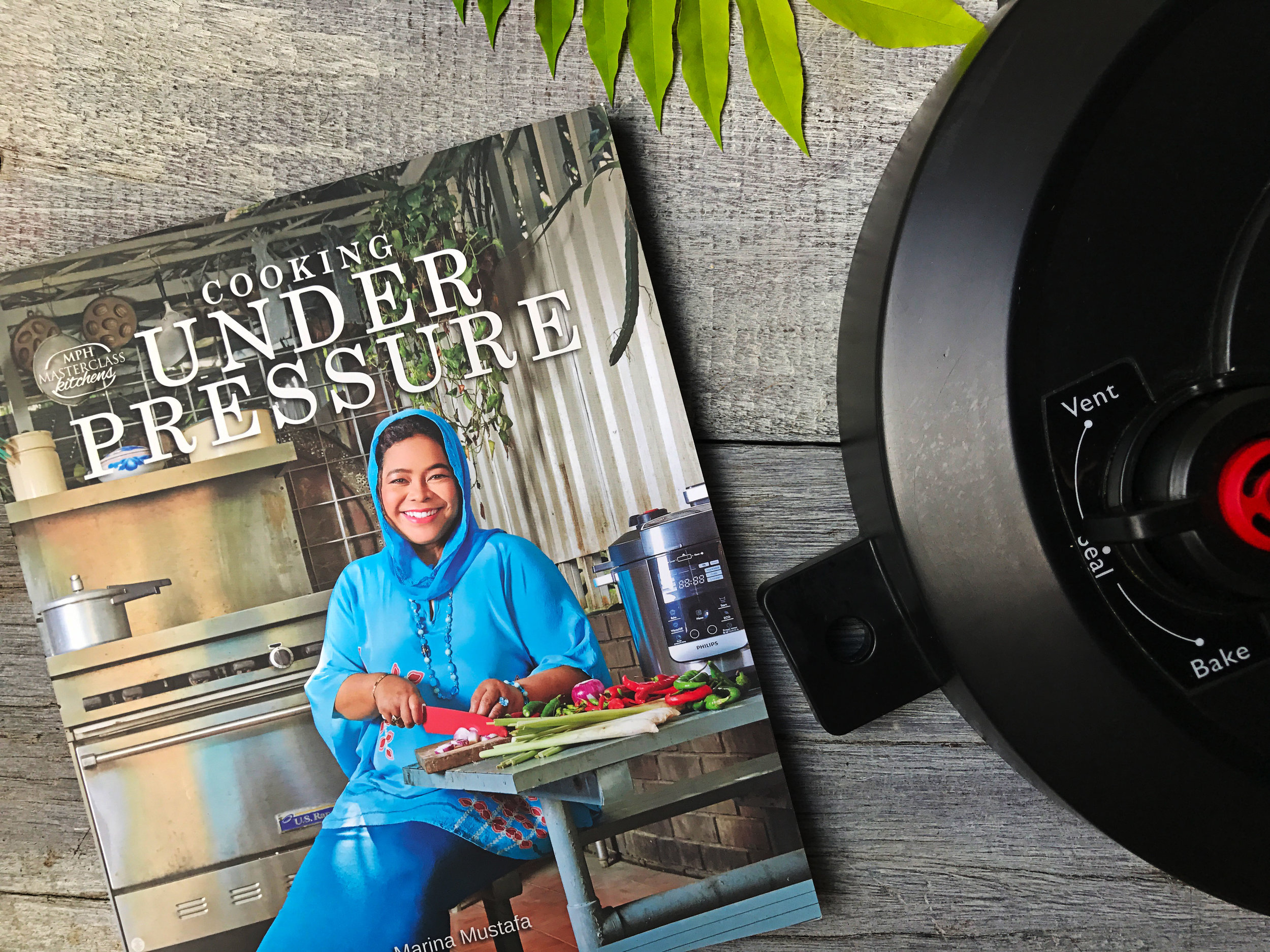 Cooking Under Pressure - This cookbook is a collaboration with Philips Malaysia, primarily of Malaysian dishes, focused on cooking with an electric pressure cooker. Nasi Lemak in 15 minutes, Salted Fish & Pineapple Gulai in 20 mins, Mee Rebus Tulang in 30 minutes! There will no pressure when cooking under pressure!