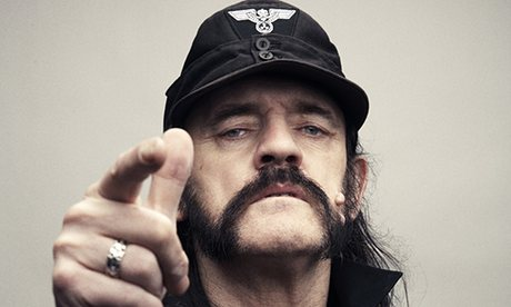 Lemmy Kilmister of Motorhead demonstrates the frowny-face, nose-flared, badass look (aka the stink face or rock out face).