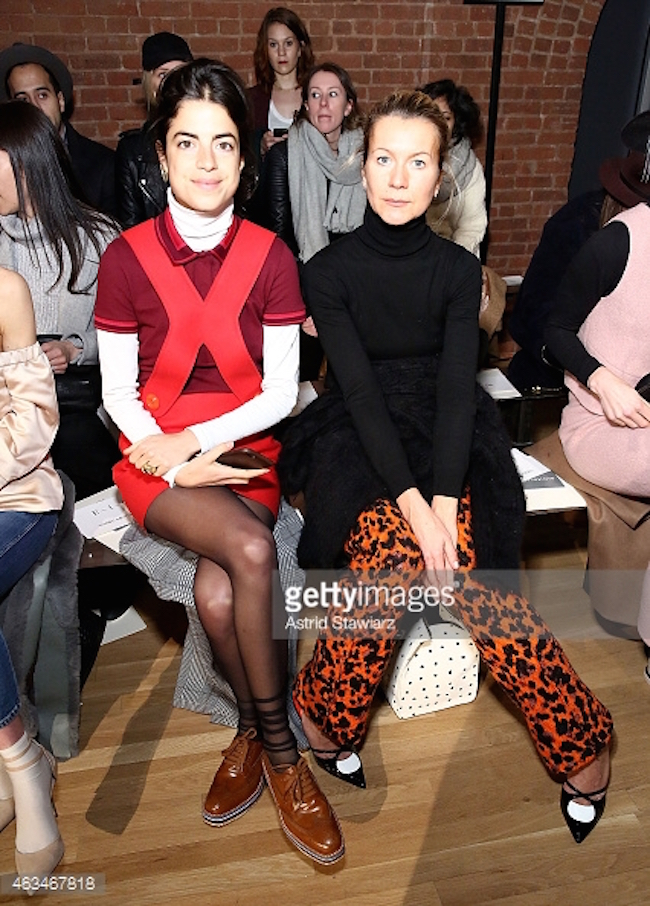 Leandra Medine and Natalie Joos sitting front row