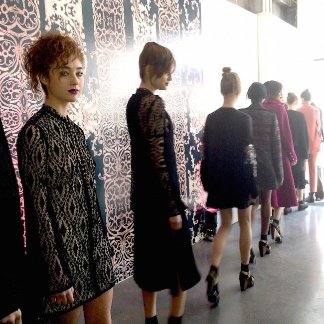 Violet Savage and models walking backstage after the show