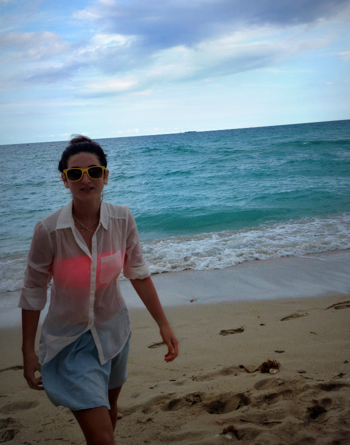beach+ready+in+chiffon+louboutins+and+love+fashion+blog+jean+skort+ocean+skirt+see-thru+bandeau+pink+love+want+model+beautiful+collar+white+shirt+pocket+sunglasses+yellow+plastic+shades+bun+sand+style+inspiration+florida+summer+trends+swim+vacation.png