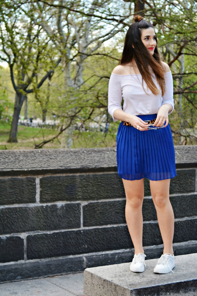 Cobalt Pleated Skirt and Leopard Belt Louboutins & Love Fashion Blog Esther Santer Shoulders Top Purple Colors Summer Spring Outfit OOTD White Sneakers Blue Topknot Hair Model Photoshoot NYC New York City Girl Beautiful Shopping Women Street Style Bun.JPG
