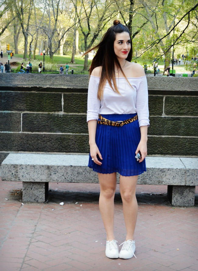 Cobalt Pleated Skirt and Leopard Belt Louboutins & Love Fashion Blog Esther Santer Shoulders Top Purple Colors Summer Spring Outfit OOTD White Sneakers Blue Topknot Hair Model Photoshoot NYC New York City Girl Beautiful Shopping Street Style Women Bun.JPG