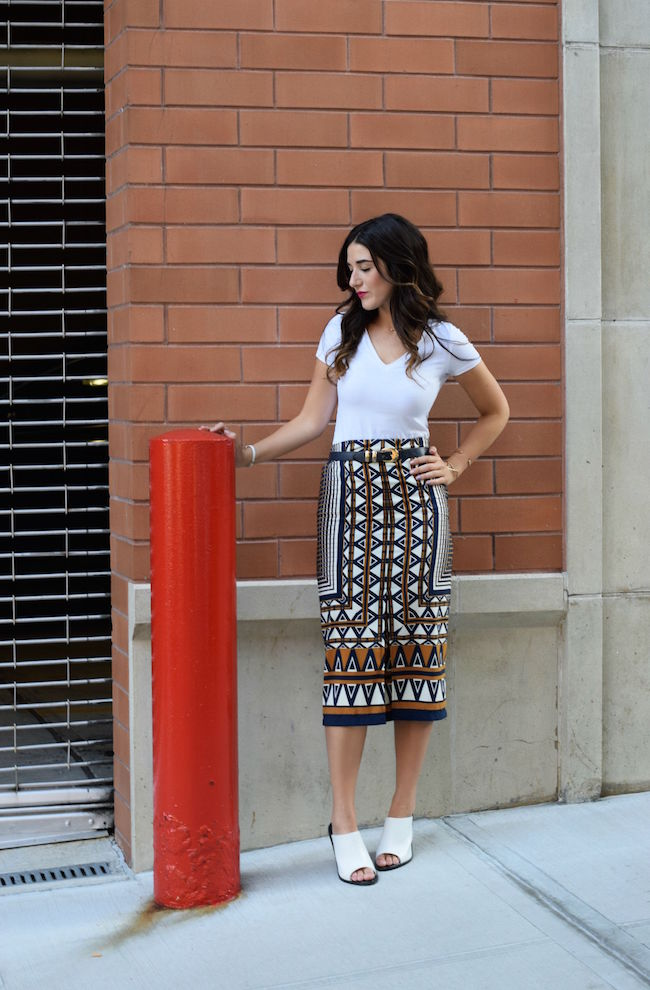 Printed Skirt White Tee Topshop Louboutins & Love Fashion Blog Esther Santer Style Blogger NYC Shoes Shop Vintage Navy Blue Belt Bracelet Jewelry Gold V-Neck Outfit OOTD Girl Women Inspiration Photoshoot Inspo Street Style Mules Rayban Aviators IfChic.jpg