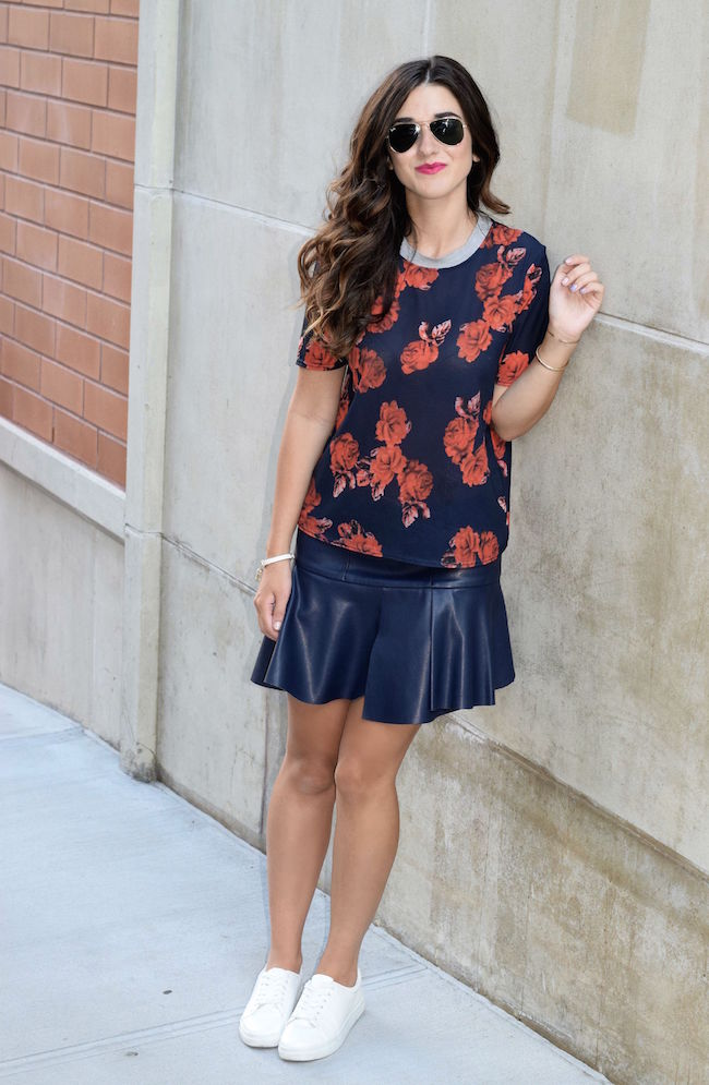 Navy Pleather Skirt White Sneakers Louboutins & Love Fashion Blog Esther Santer Street Style Blogger NYC Blue Grey Bracelet Gold Jewelry Brunette Hair Floral Top Girl Women Beauty Photoshoot Model Outdoors Outfit OOTD Lifestyle Blogger Red Zara Shop.jpg