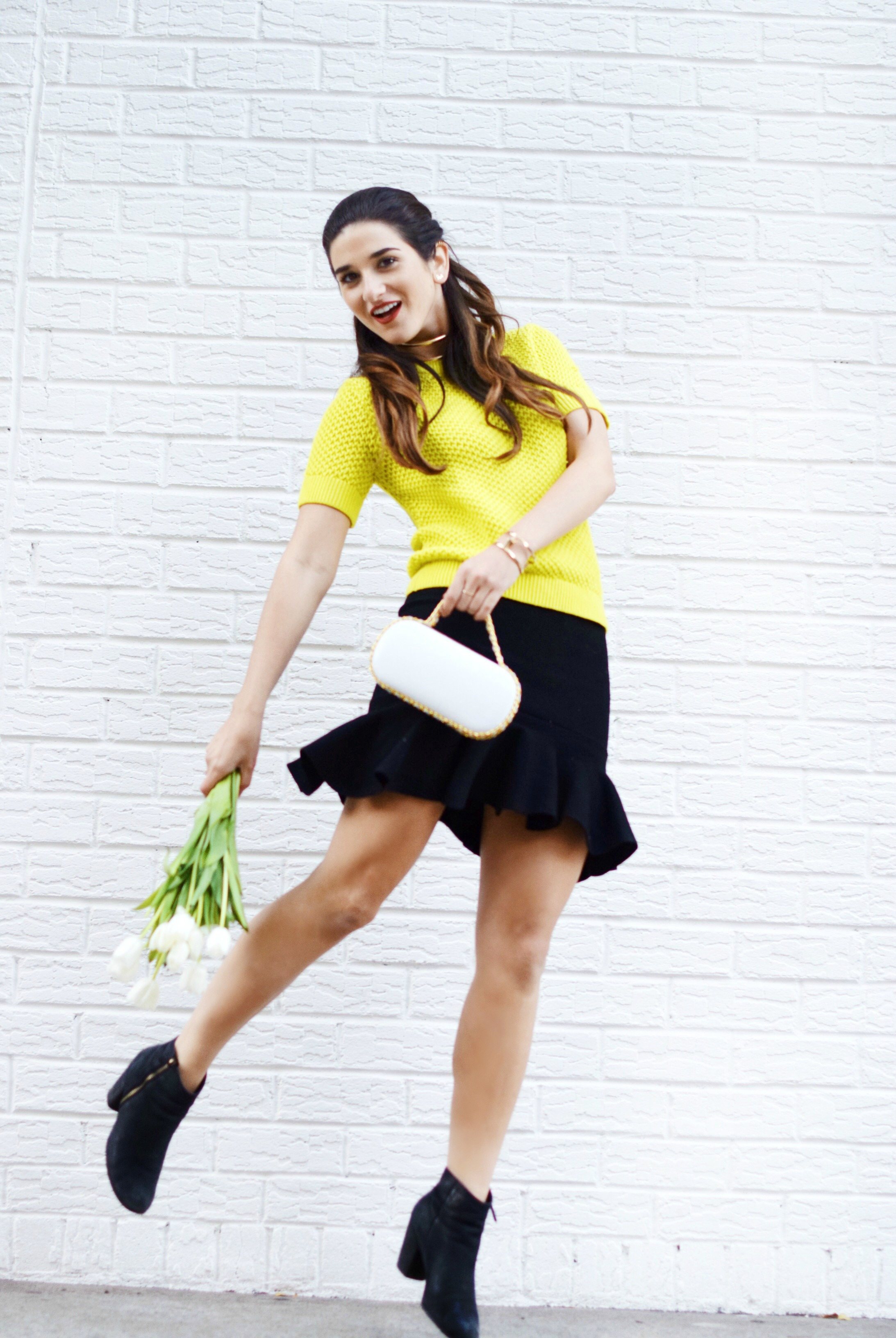 White Prince Minaudiere Erin Dana Louboutins & Love Fashion Blog Esther Santer NYC Street Style Blogger Bag Giveaway Gold Jewelry Lydell Bracelet Collar Necklace Black Booties Flared Ruffle Skirt Neon Yellow Sweater Club Monaco Model Photoshoot Outfit.jpg